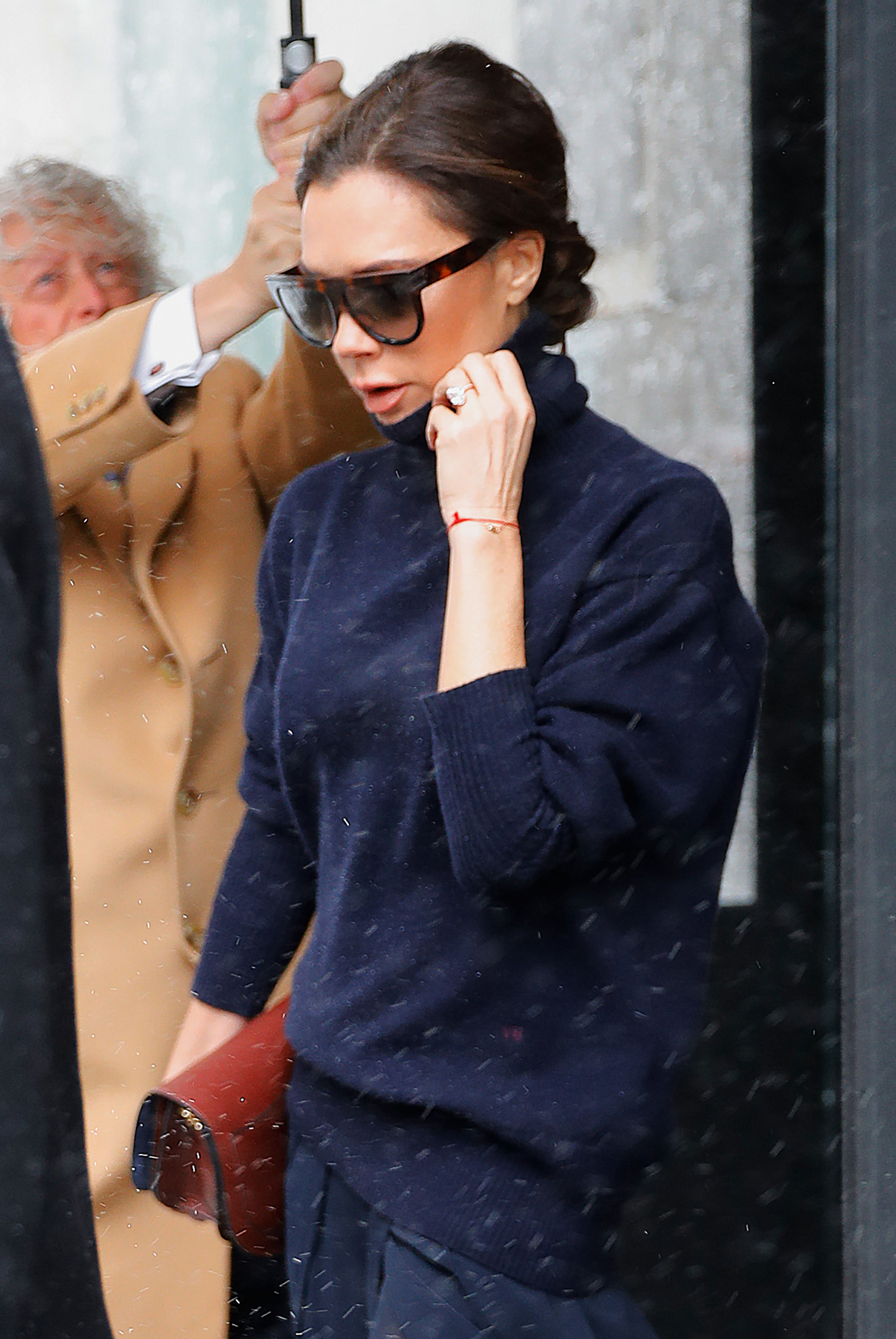 Victoria Beckham heads out in another navy outfit when out in New York <P> Pictured: Victoria Beckham <B>Ref: SPL1461995  140317  </B><BR/> Picture by: Splash News <BR/> </P><P> <B>Splash News and Pictures</B><BR/> Los Angeles:310-821-2666<BR/> New York:212-619-2666<BR/> London:870-934-2666<BR/> <span id=