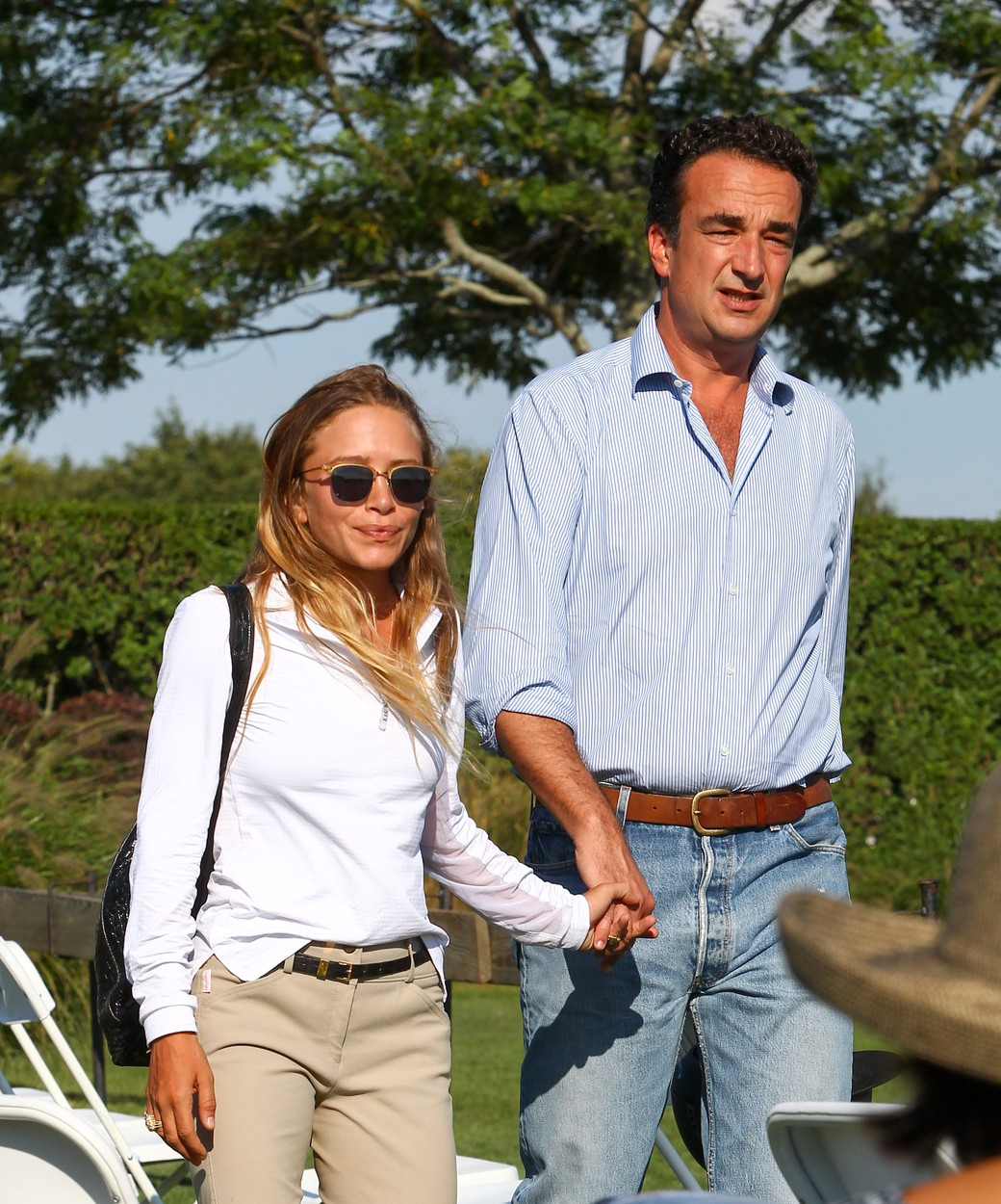 EXCLUSIVE TO INF. August 27, 2015: Mary-Kate Olsen, dressed in riding gear, and husband Olivier Sarkozy, are seen holding hands while attending the 2015 Hampton Classic Horse Show in the Hamptons, New York. Mary-Kate and twin sister Ashley are currently involved in a lawsuit filed against their company, Dualstar. The suit was brought by a group of former interns who are claiming the company has failed to pay about 40 past and present employees, who had to work long hours performing menial tasks., Image: 256682216, License: Rights-managed, Restrictions: CODE000, Model Release: no, Credit line: Profimedia, INF