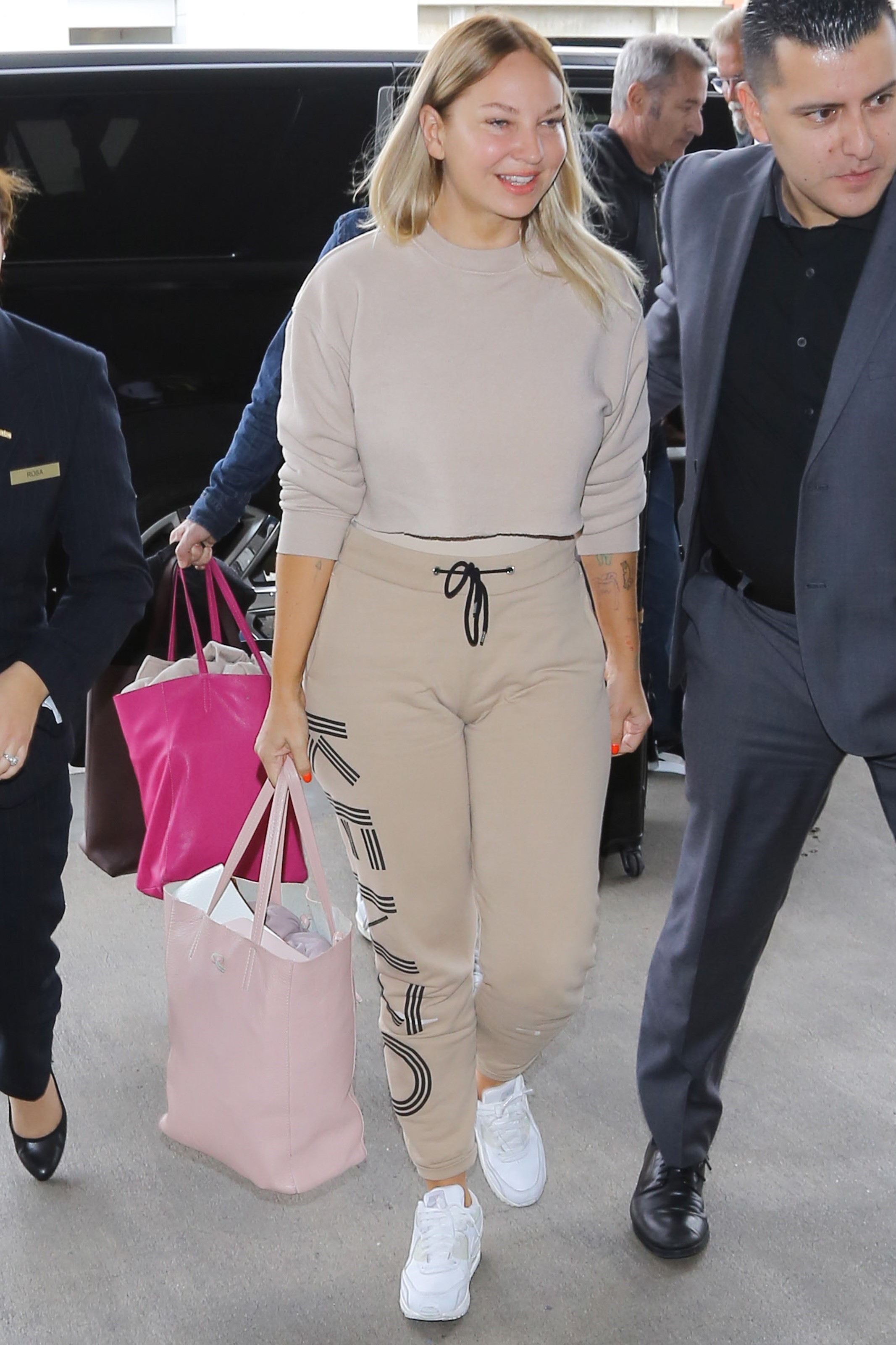 AG_182642 -  - Los Angeles, CA - Sia is spotted unmasked as she dashes to a flight out of LA. The usually reserved singer looks fresh and makeup free as she sports a nude colored Kenzo outfit while walking through the terminal.  Pictured: Sia  22 MARCH 2017  BYLINE MUST READ: Vasquez-Max Lopes     Maria Buda (917) 242-1505 mbuda@akmgsi.com   Mark Satter (317) 691-9592 msatter@akmgsi.com or sales@akmgsi.com, Image: 326192674, License: Rights-managed, Restrictions: , Model Release: no, Credit line: Profimedia, AKM-GSI