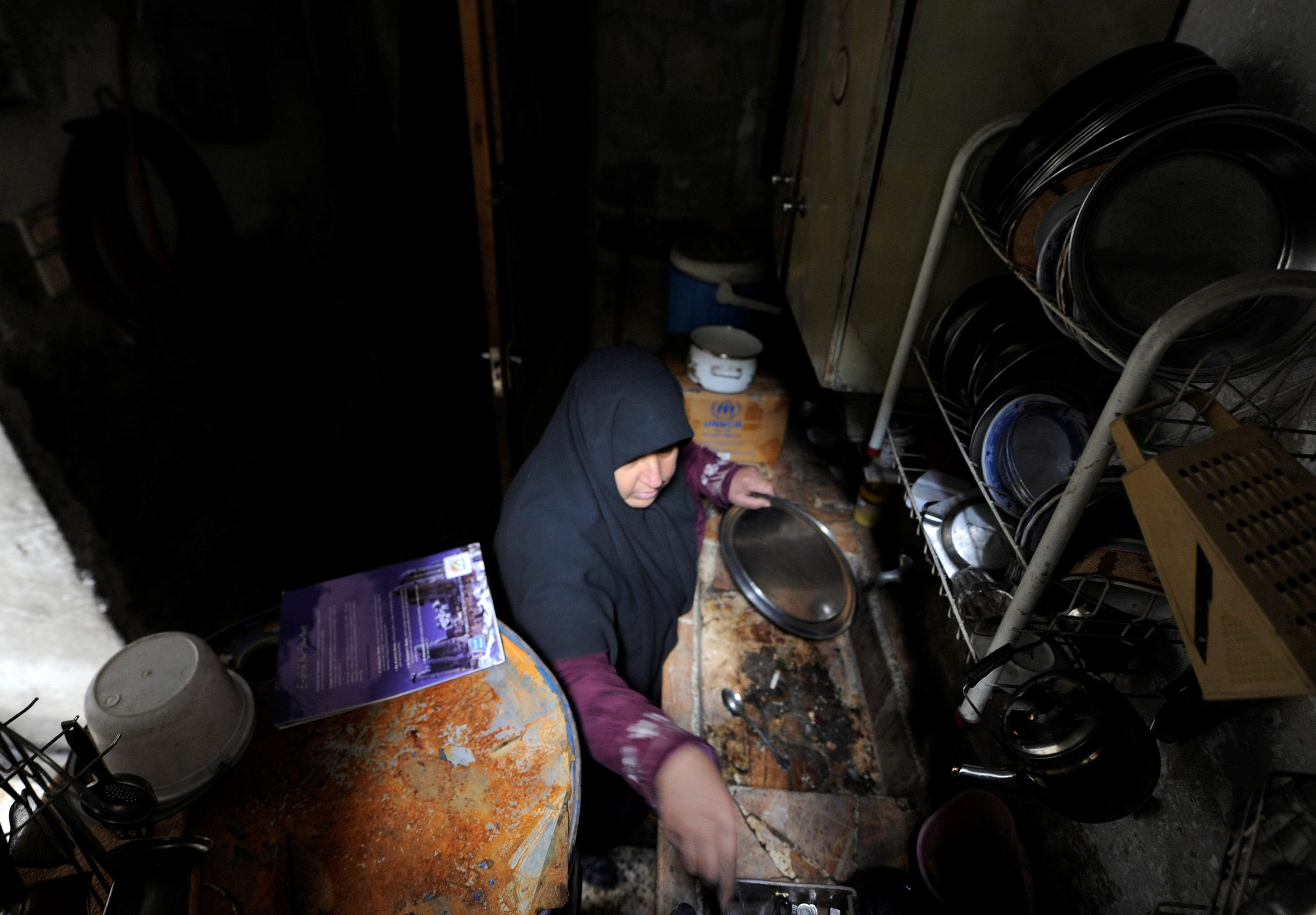 Heyam Batash, 56, works inside her kitchen in al-Mouassassi street in Aleppo, Syria, January 30, 2017. Picture taken January 30, 2017. REUTERS/Omar Sanadiki
