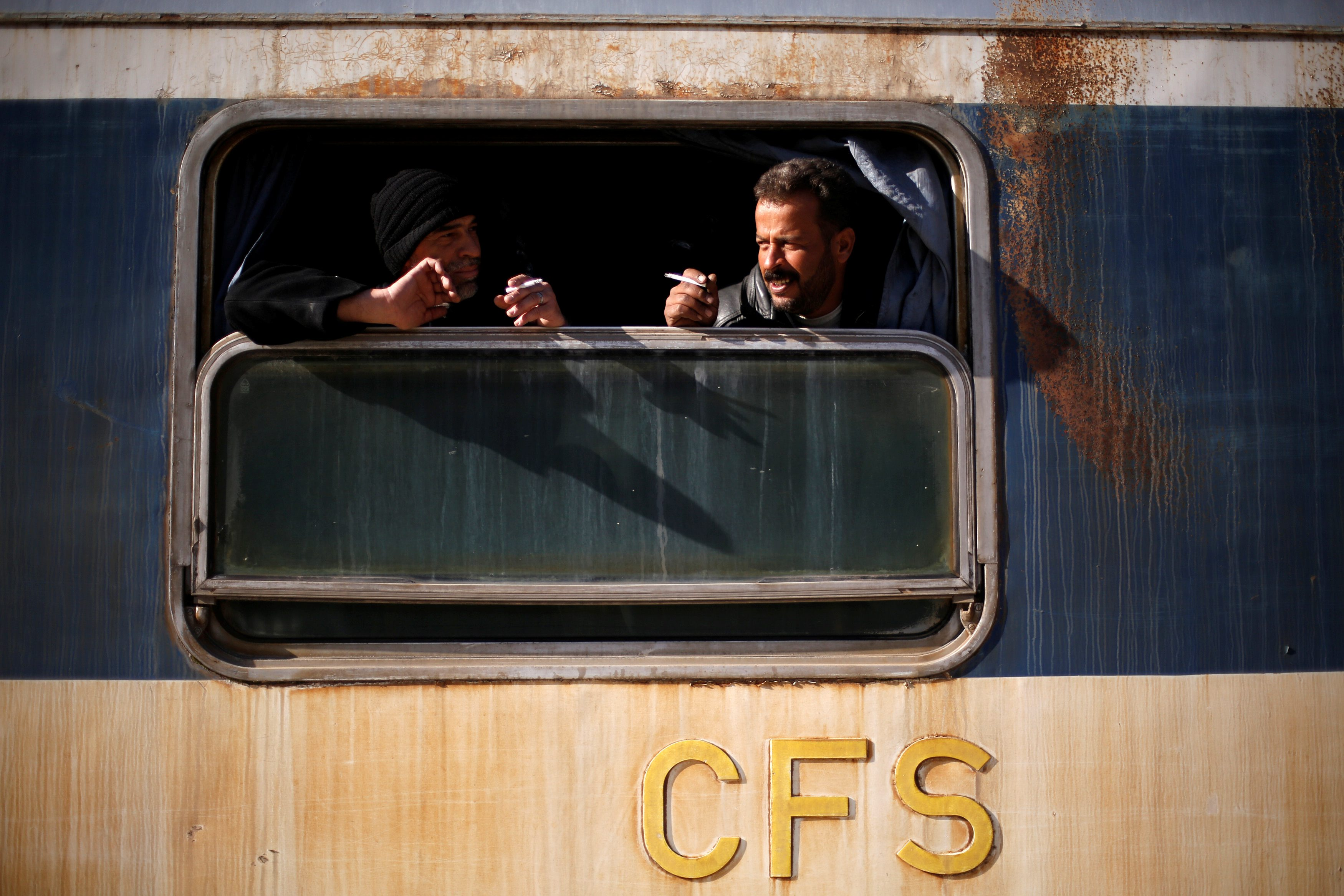 People ride a train at Baghdad Station in west Aleppo, Syria February 1, 2017. Picture taken February 1, 2017. REUTERS/Omar Sanadiki