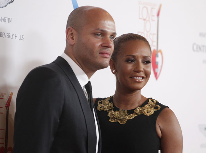 Stephen Belafonte (L) poses with his wife Melanie Brown at the 20th annual Race to Erase MS benefit gala in Los Angeles, California May 3, 2013. The event raises money to fund research to find a cure for multiple sclerosis. REUTERS/Fred Prouser (UNITED STATES - Tags: ENTERTAINMENT) - RTXZ9V2