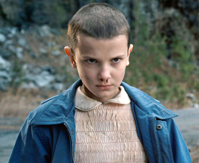USA. Millie Bobby Brown in a scene from the ©Netflix new TV series: Stranger Things (2016).  Plot: When a young boy disappears, his mother must confront terrifying forces in order to get him back., Image: 294452523, License: Rights-managed, Restrictions: Supplied by Landmark Media. Editorial Only. Landmark Media is not the copyright owner of these Film or TV stills but provides a service only for recognised Media outlets., Model Release: no, Credit line: Profimedia, Landmark