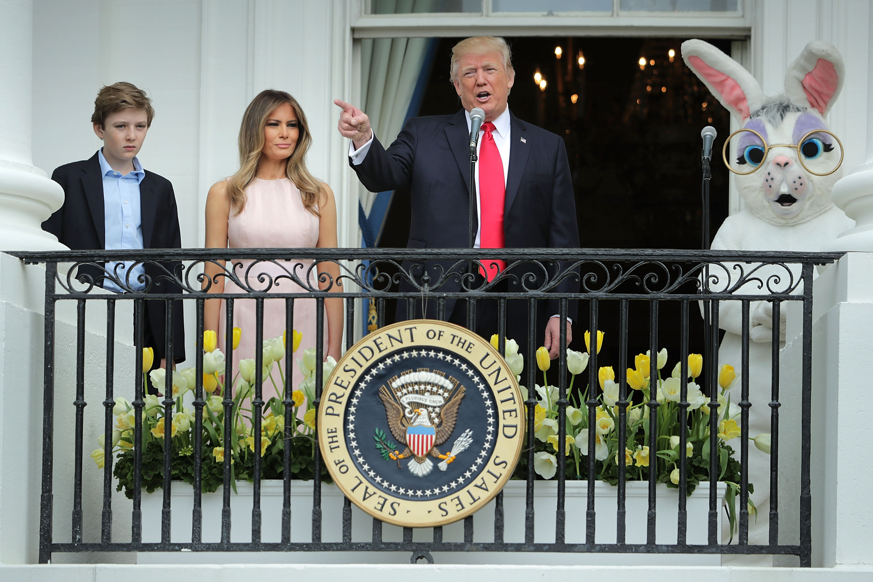 WASHINGTON, DC - APRIL 17:  U.S. President Donald Trump (C) delivers remarks from the Truman Balcony with first lady Melania Trump and their son Barron Trump (L) during the 139th Easter Egg Roll on the South Lawn of the White House April 17, 2017 in Washington, DC. The White House said 21,000 people are expected to attend the annual tradition of rolling colored eggs down the White House lawn that was started by President Rutherford B. Hayes in 1878.  (Photo by Chip Somodevilla/Getty Images)