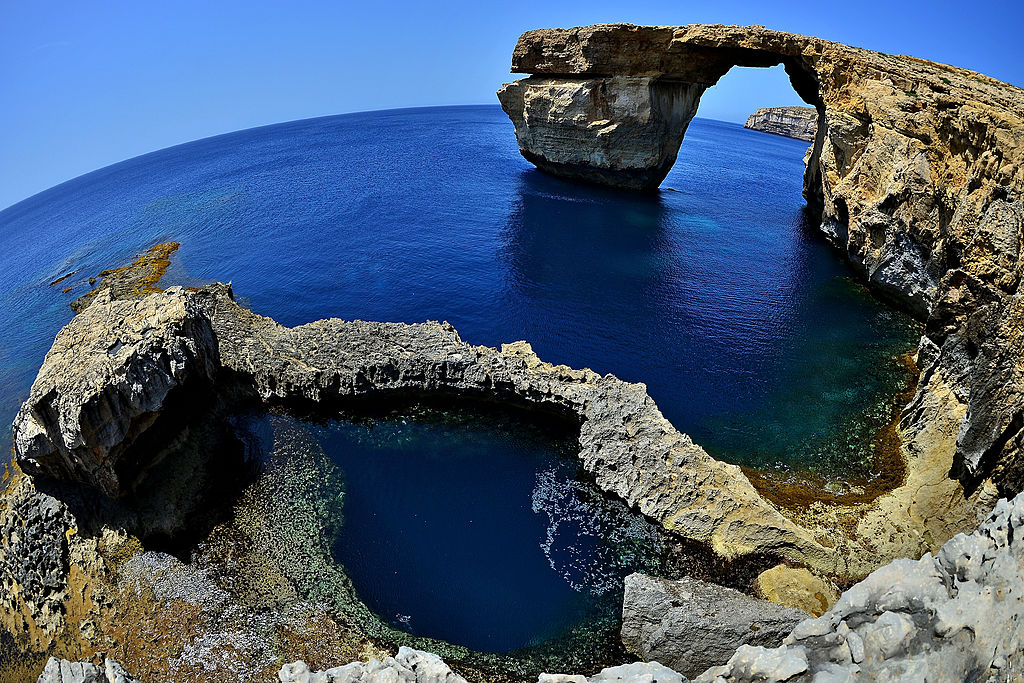 DWEJRA, GOZO - MAY 20:  The natural arch 'The Azure Window' is seen at Dwejra Bay on May 20, 2014 in Dwejra/Gozo, Malta.  (Photo by Sascha Steinbach/Getty Images)