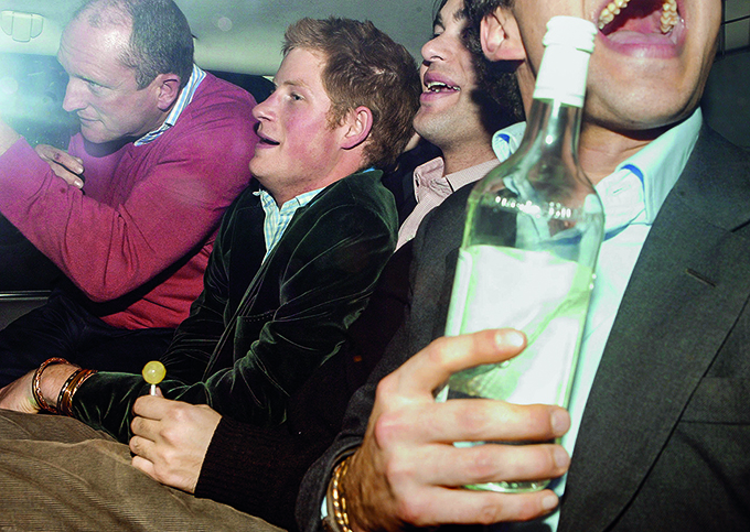 PICTURE BY: © ALLEN - VERCILLO  / MATRIXPHOTOS.COM  PLEASE CREDIT ALL USES  A rather tipsy, red faced Prince Harry pictured leaving the Embassy nightclub in London with several boozy pals, after a nightout with brother Prince William and his girlfriend Kate Middleton. London. UK.  20TH DECEMBER 2006  JOB: 44701  TEL: +44 845 345 7072