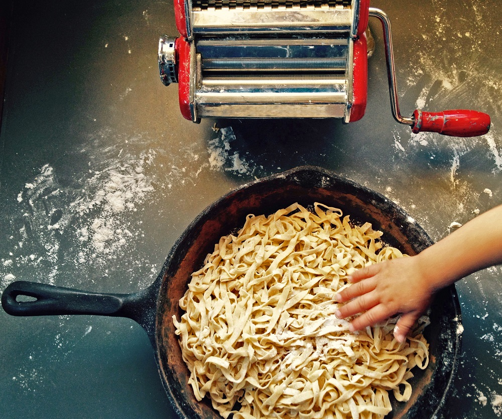 Homemade pasta noodles are waiting to be cooked in a pan