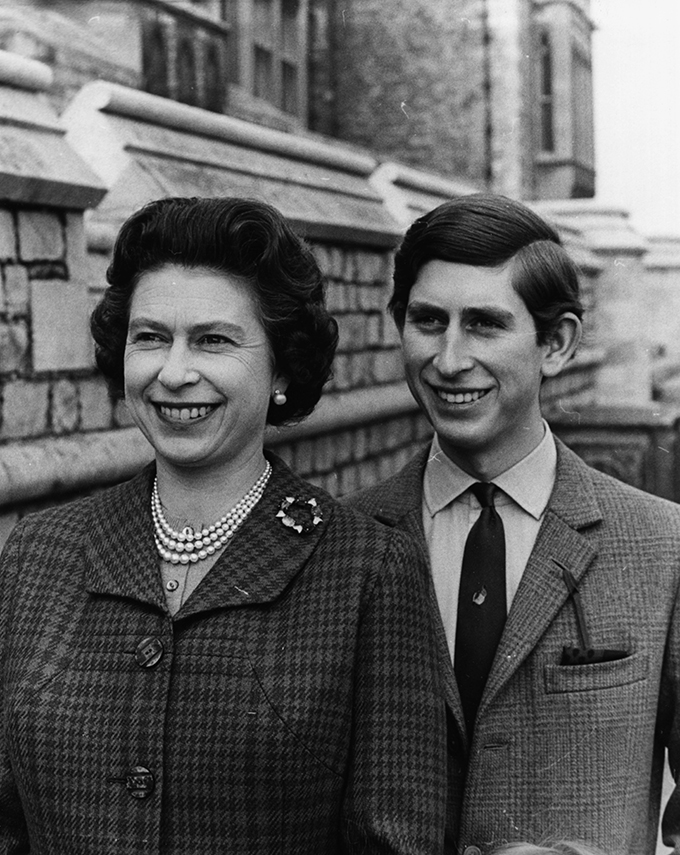 Informal portrait of Prince Charles and his mother, Queen Elizabeth II, in the grounds of Windsor Castle, April 1969. (Photo by Central Press/Hulton Archive/Getty Images)