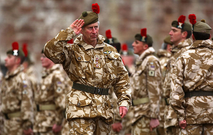FORT GEORGE, UNITED KINGDOM - JANUARY 20:  Prince Charles, Prince of Wales presents campaign medals to soldiers from the Black Watch on January 20, 2010 in Fort George, Scotland. The regiment lost five soldiers during the seven month tour of Afghanistan.  (Photo by Jeff J Mitchell/Getty Images)
