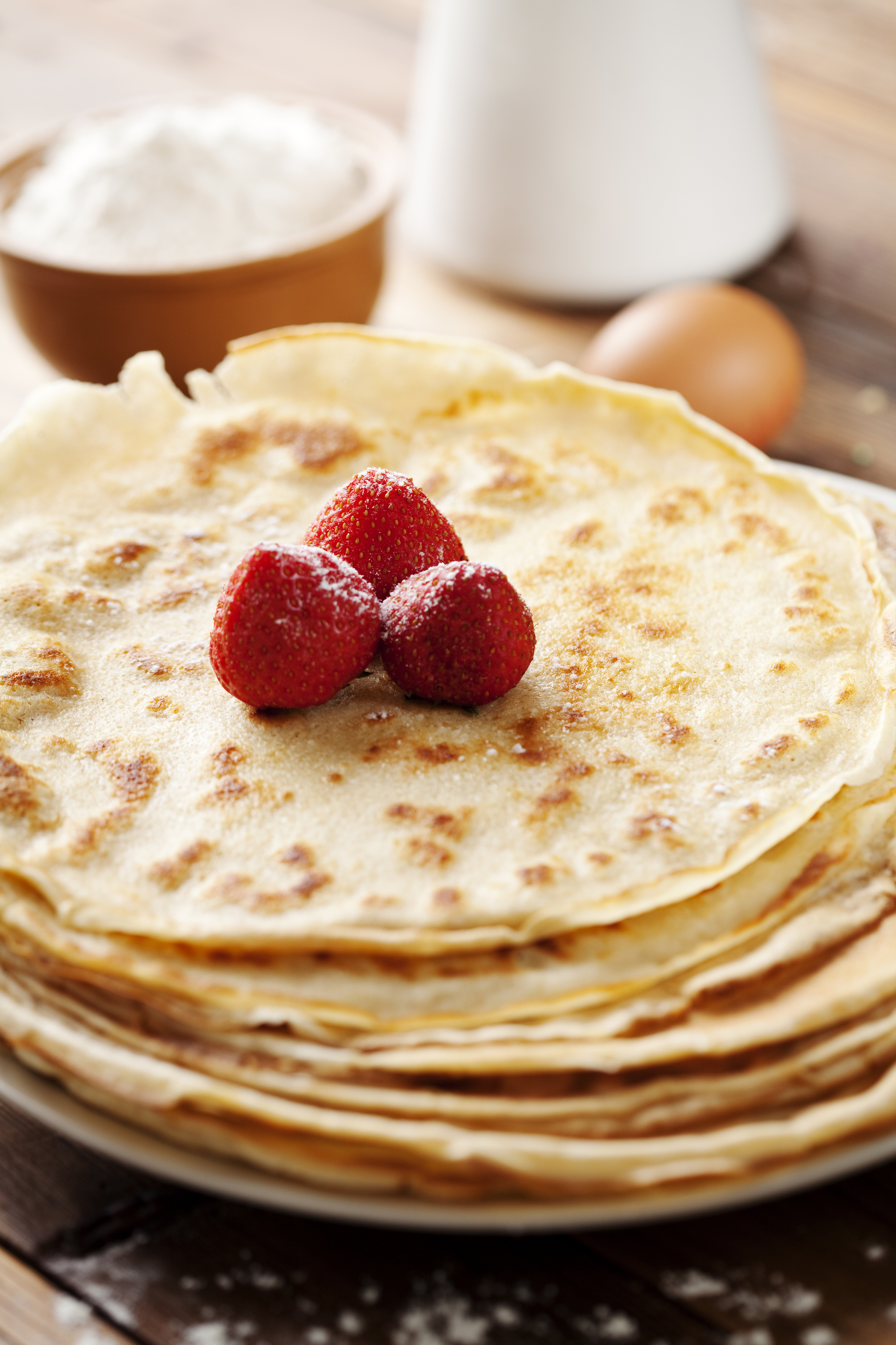 close up of two french style crepes, shallow dof. Some ingredients in the background
