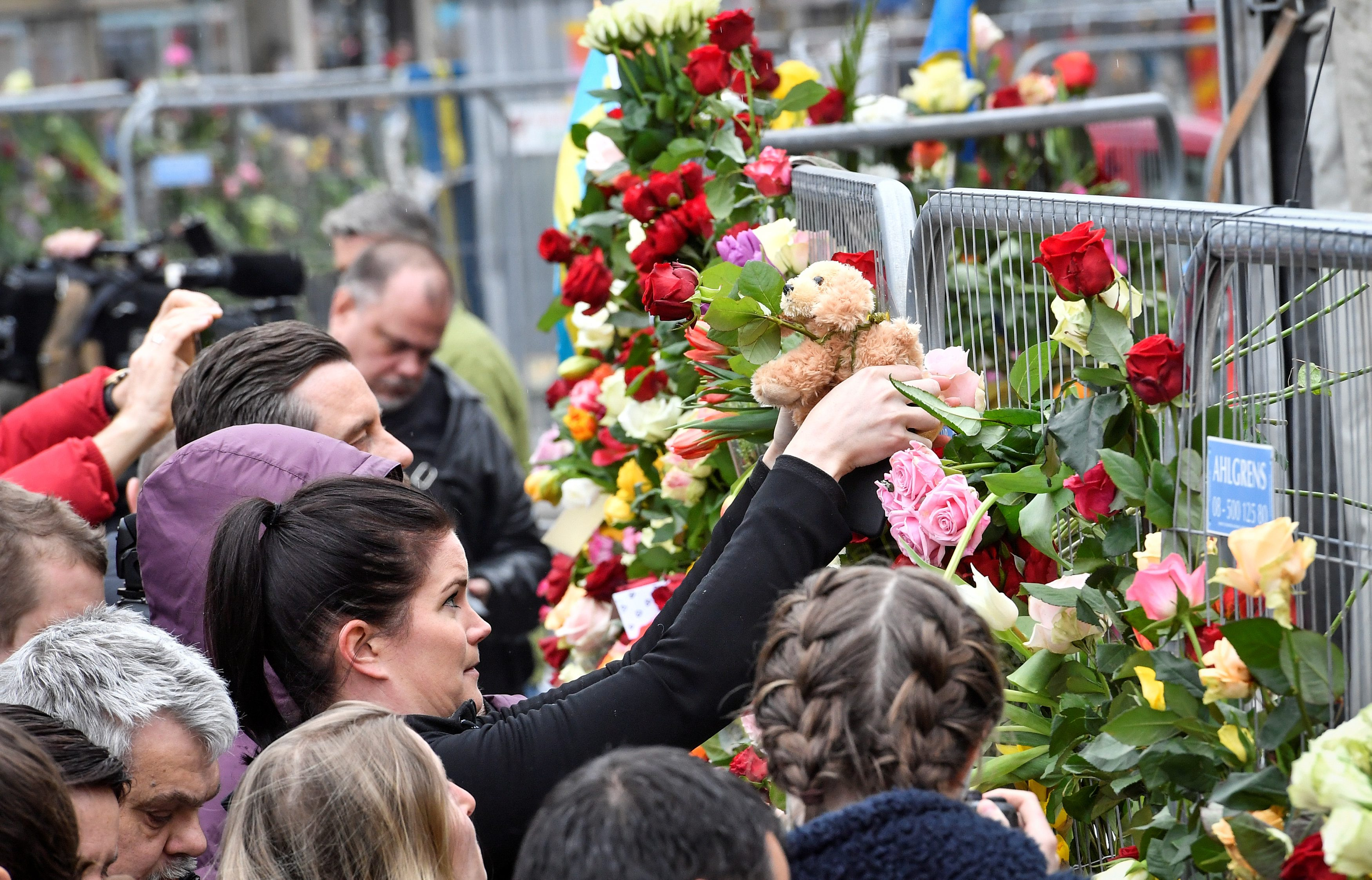 STOCKHOLM 2017-04-08 People gather at the crime scene near Ahlens department store in central Stockholm on April 08, 2017, the day after a hijacked beer truck plowed into pedestrians on Drottninggatan and crashed into Ahlens department store, killing four people, injuring 15 others. TT News Agency/Jonas Ekstromer/via REUTERS     ATTENTION EDITORS - THIS IMAGE WAS PROVIDED BY A THIRD PARTY. EDITORIAL USE ONLY. SWEDEN OUT.
