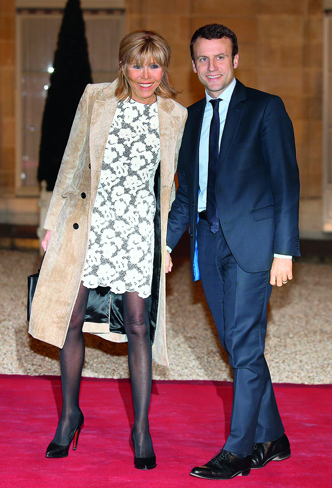 PARIS, FRANCE - MARCH 10: French Minister of Economy Emmanuel Macron and his wife Brigitte Trogneux arrive at The State Dinner in Honor Of King Willem-Alexander of the Netherlands and Queen Maxima at Elysee Palace on March 10, 2016 in Paris, France. Queen Maxima and King Willem-Alexander of The Netherlands are on a two-day state visit in France. (Photo by Jean Catuffe/Getty Images)