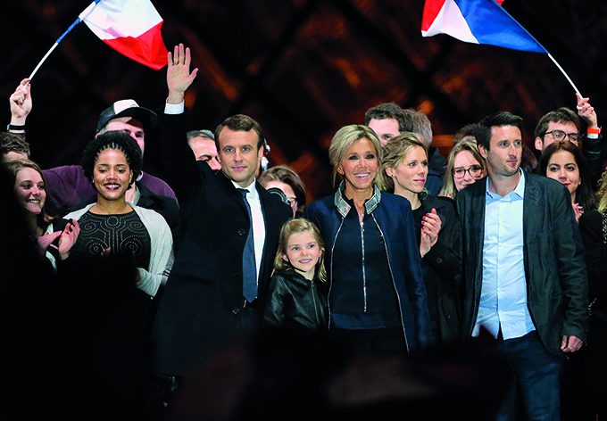 PARIS, FRANCE - MAY 7: Newly French President elected Emmanuel Macron, his wife Brigitte Macron, her grand daughter Emma (daughter of Laurence Auziere) and her other daughter Tiphaine Auziere (to her left) celebrate his presidential election victory at Le Louvre plaza on May 7, 2017 in Paris, France. (Photo by Jean Catuffe/Getty Images)