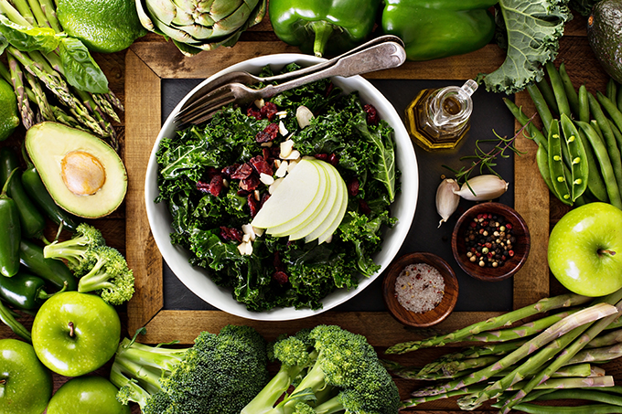 Healthy eating concept with kale salad and green vegetables