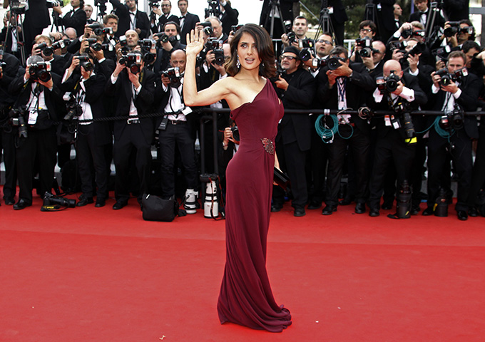 Actress Salma Hayek waves as she arrives for the screening of