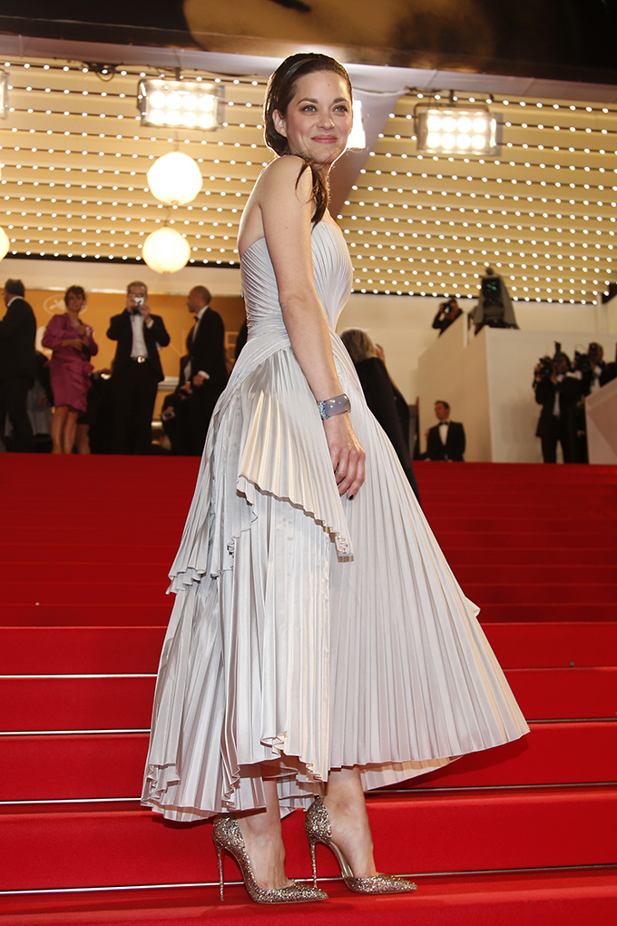 Actress Marion Cotillard poses on the red carpet as she arrives for the screening of the film