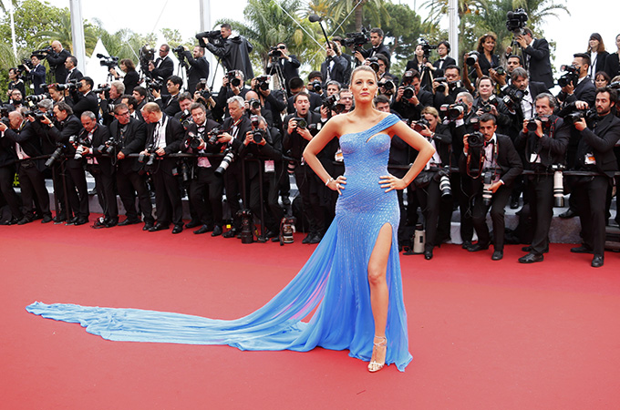 Actress Blake Lively poses on the red carpet as she arrives for the screening of the film