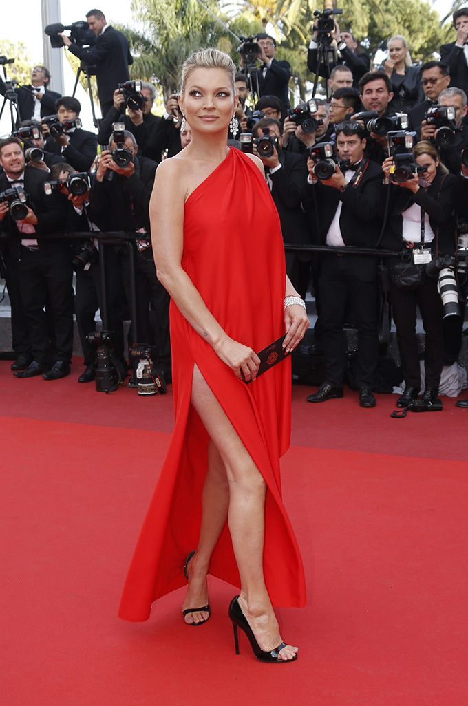 Model Kate Moss poses on the red carpet as she arrives for the screening of film