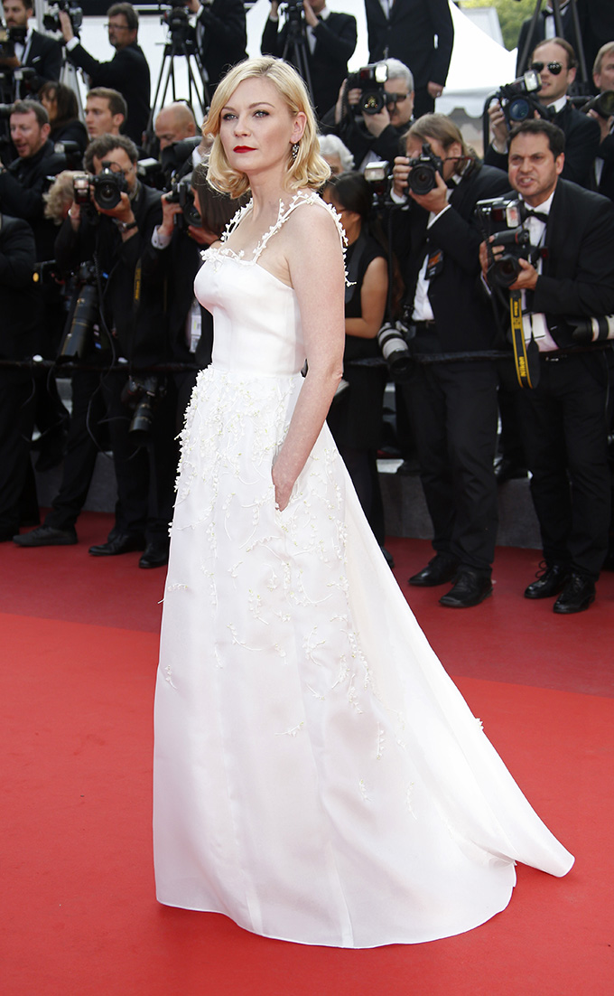 Jury member actress Kirsten Dunst poses on the red carpet as she arrives for the screening of film