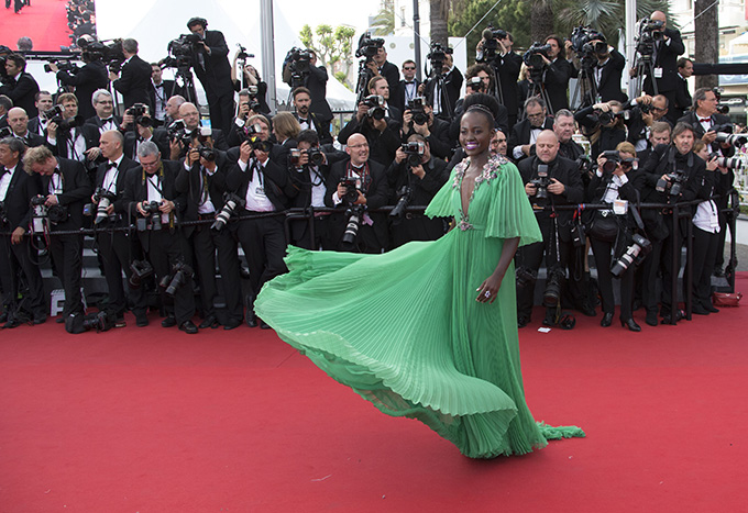 Actress Lupita Nyong'o poses on the red carpet as she arrives for the opening ceremony and the screening of the film