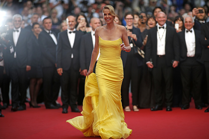 Cast member Charlize Theron poses on the red carpet as she arrives for the screening of the film