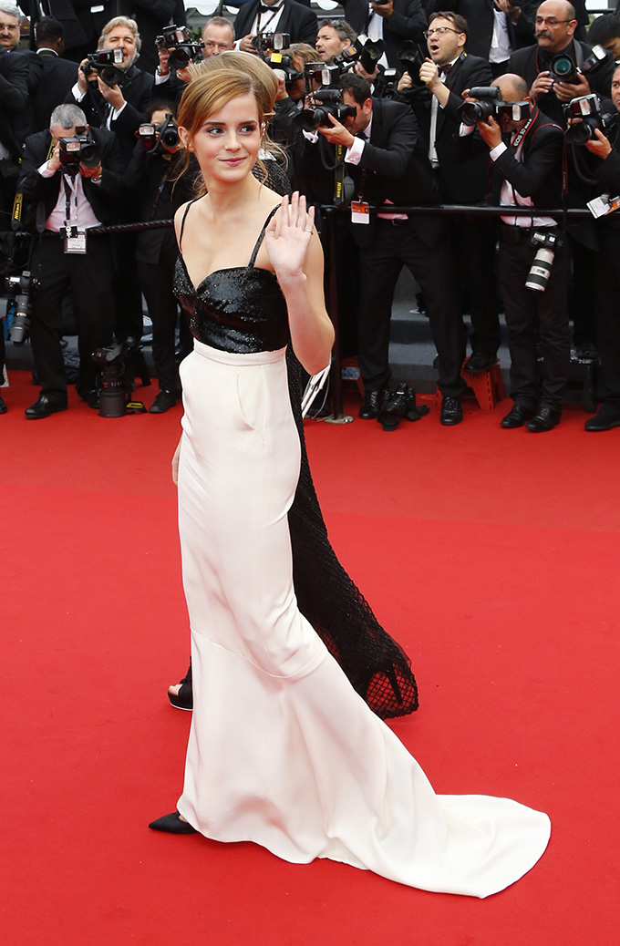 Actress Emma Watson poses on the red carpet as she arrives for the screening of the film 'The Bling Ring' in competition in