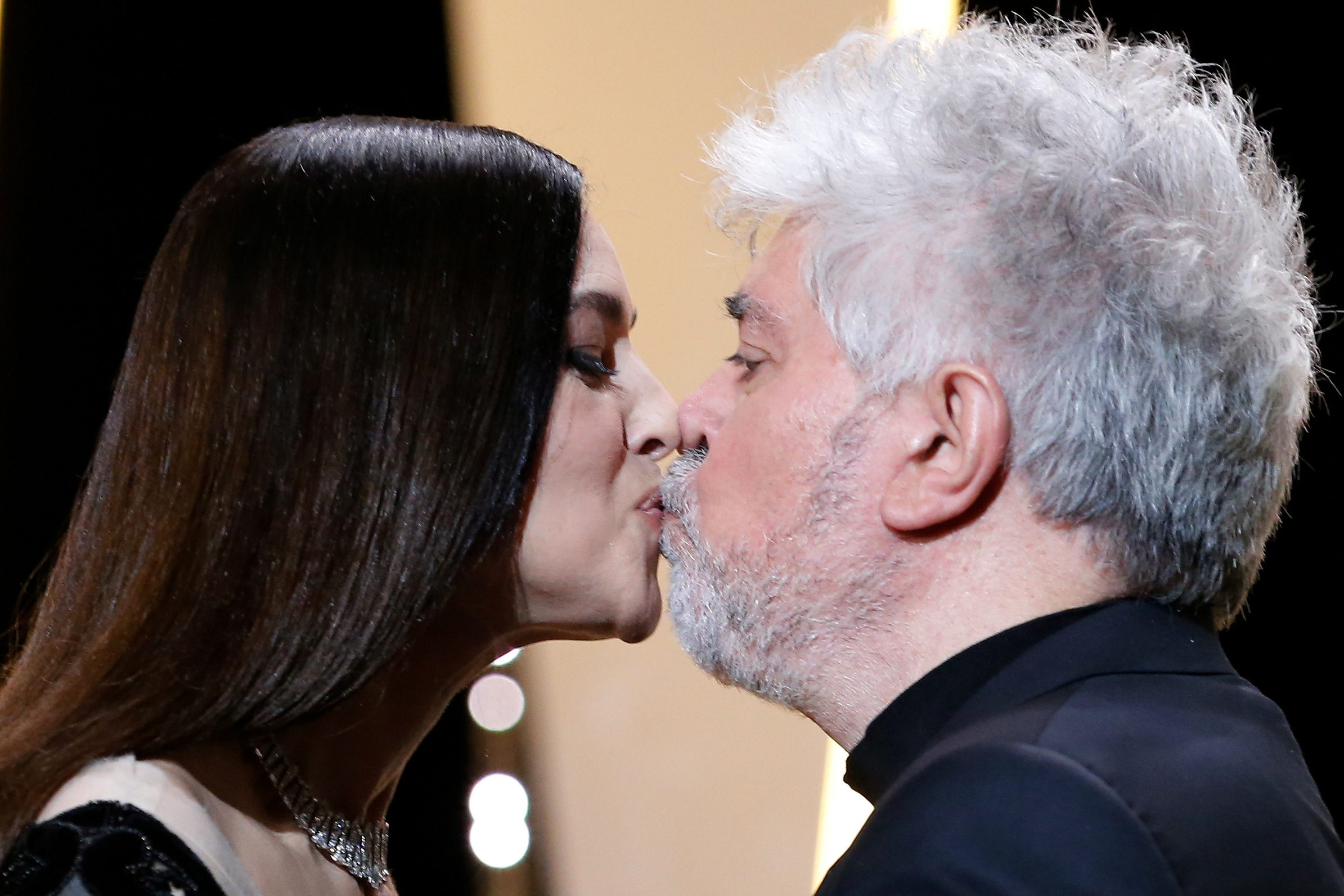 70th Cannes Film Festival - Closing ceremony - Cannes, France. 28/05/2017. Mistress of Ceremony actress Monica Bellucci kisses Director Pedro Almodovar, Jury President of the 70th Cannes Film Festival, on stage. REUTERS/Stephane Mahe     TPX IMAGES OF THE DAY