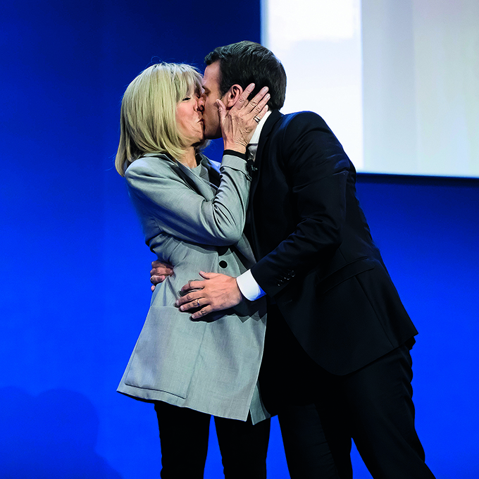 PARIS, FRANCE - APRIL 23:  Founder and Leader of the political movement 'En Marche !' and presidential candidate Emmanuel Macron (R), with his wife Brigitte Trogneux (L), addresses activists after the announcement of the French presidential Election results on April 23, 2017 in Paris, France. According to projected results, founder and leader of the political movement 'En Marche !' Emmanuel Macron has received the most votes with National Front Party leader Marine Le Pen in second place, meaning both will now compete against each other in the next round of the French Presidential Elections on May 7.  (Photo by Vincent Isore/IP3/Getty Images)