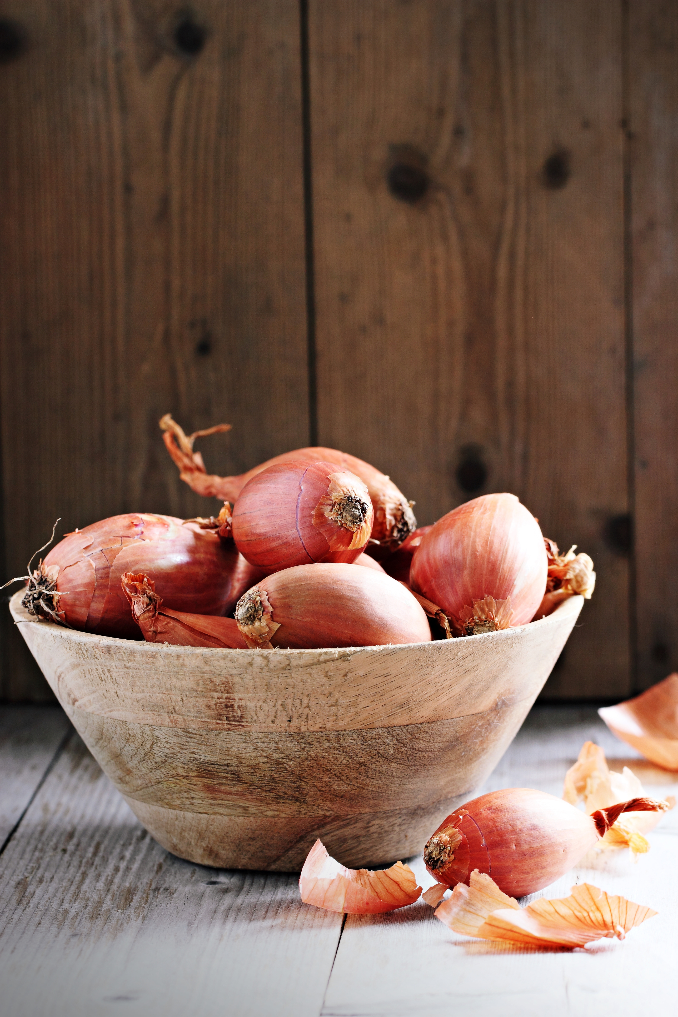 Shallot on a rustic wooden table.Selective focus