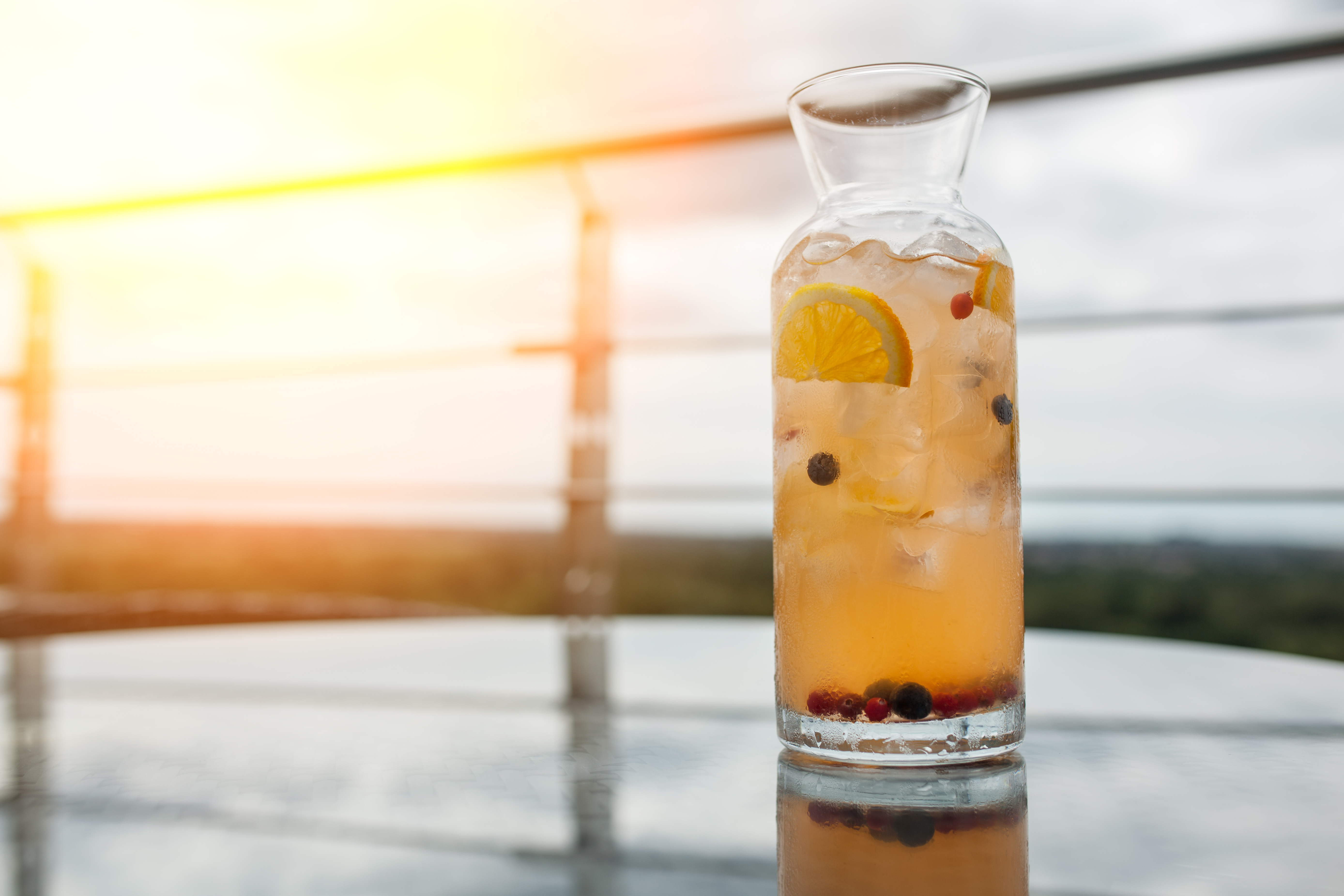 cold drink with orange, spices and ice;