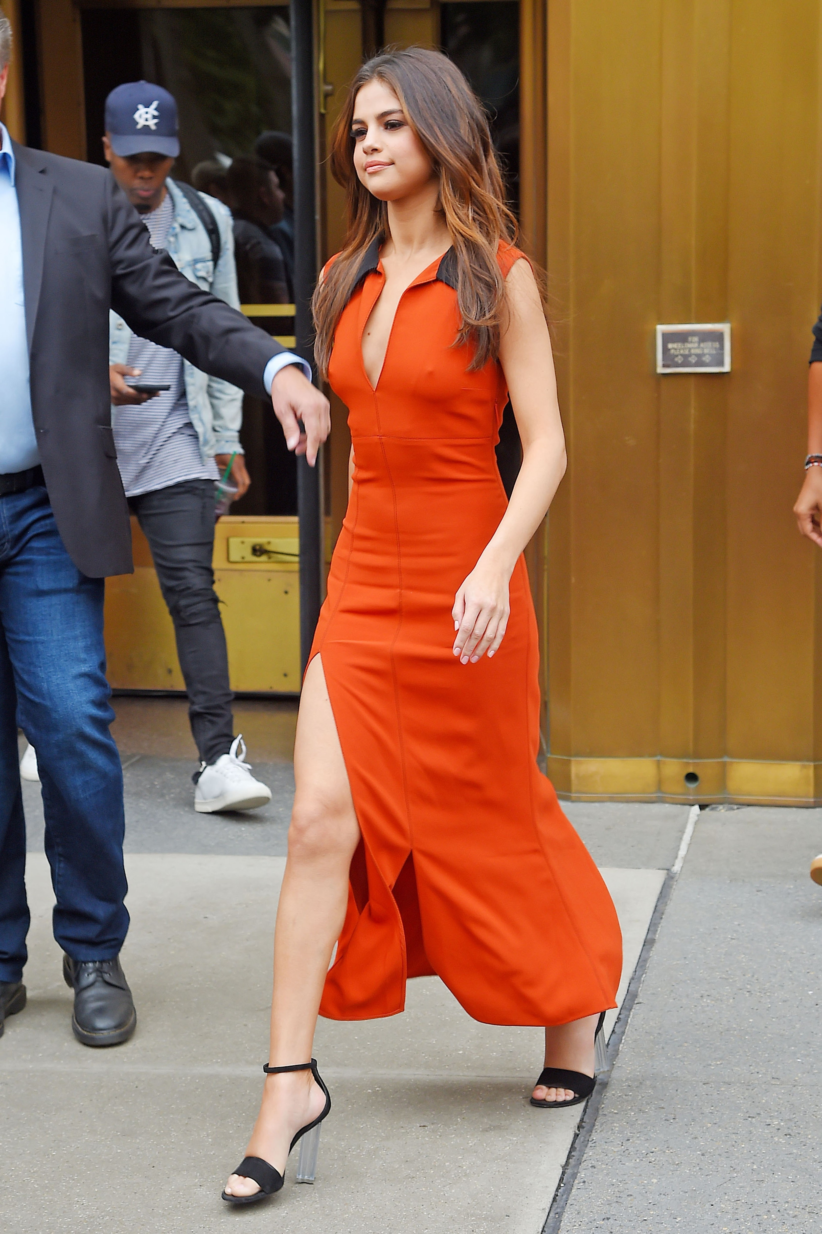 New York, NY  - Selena Gomez looks stunning going braless in a form fitted orange dress that shows off some leg as she leaves the z100 Radio Station.  Pictured: Selena Gomez  BACKGRID USA 5 JUNE 2017, Image: 335152969, License: Rights-managed, Restrictions: , Model Release: no, Credit line: Profimedia, AKM-GSI