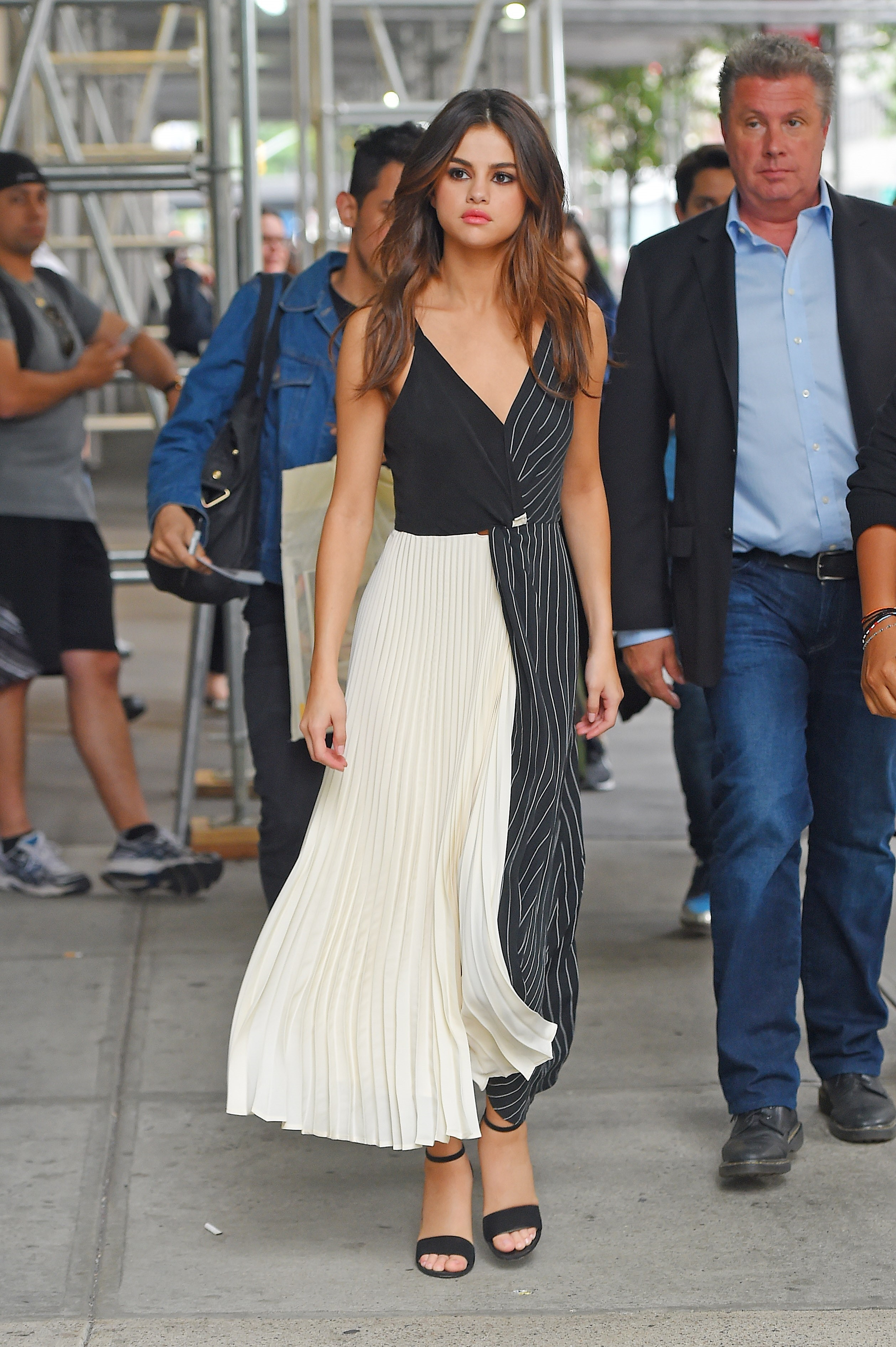 New York, NY  - Selena Gomez steps out in Manhattan sporting her fourth look of the day. The brunette is wearing a pleated color block jumpsuit paired with heels.  Pictured: Selena Gomez  BACKGRID USA 5 JUNE 2017, Image: 335190633, License: Rights-managed, Restrictions: , Model Release: no, Credit line: Profimedia, AKM-GSI