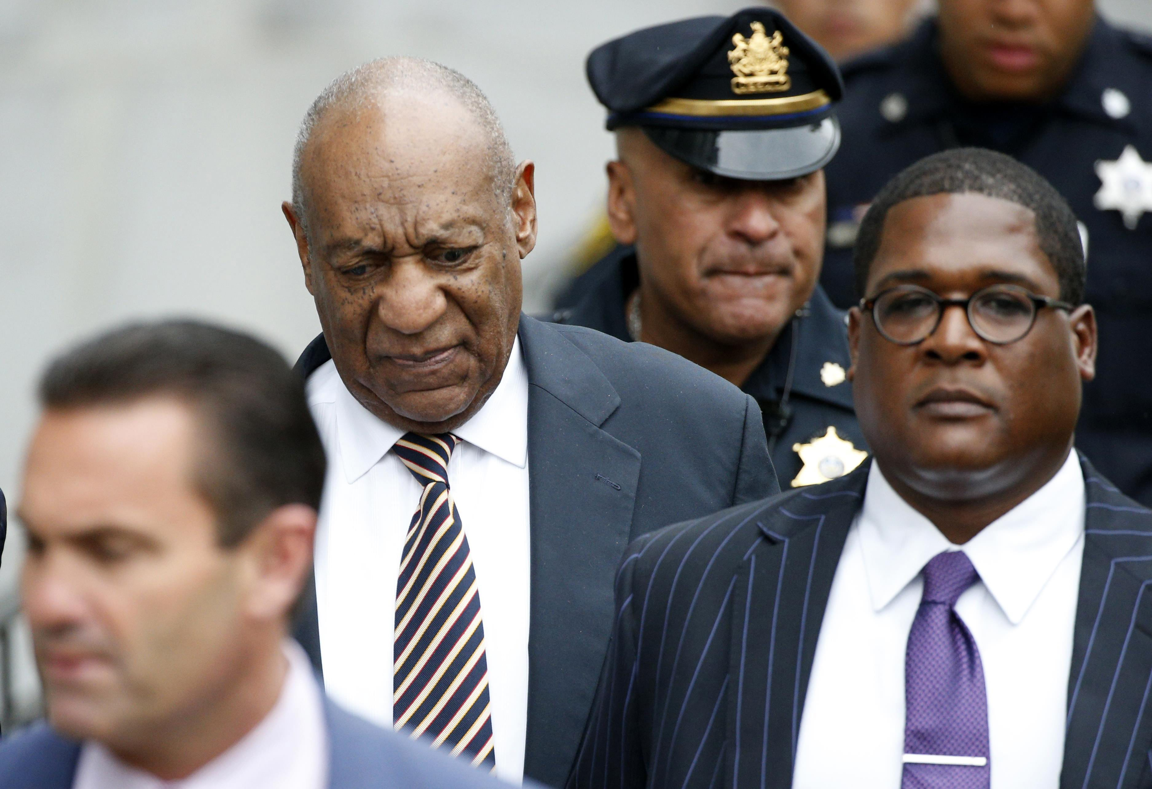 Actor and comedian Bill Cosby (2nd L) leaves with lawyer Fortunato N. Perri, Jr. (L) and spokesman Andrew Wyatt after the first day of his sexual assault trial at the Montgomery County Courthouse in Norristown, Pennsylvania, U.S. June 5, 2017. REUTERS/Brendan McDermid . TPX IMAGES OF THE DAY