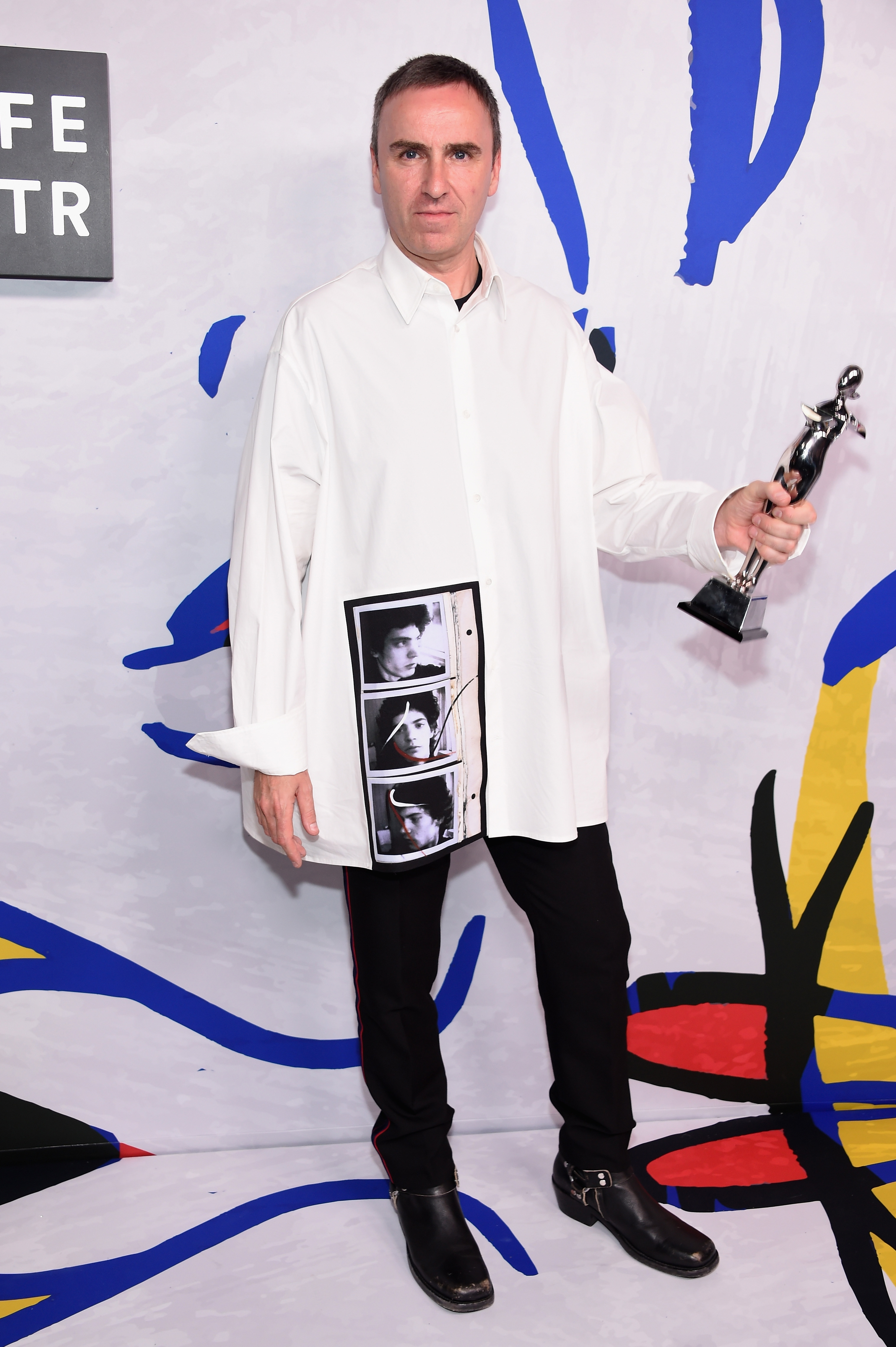 NEW YORK, NY - JUNE 05:  Designer Raf Simons for Calvin Klein poses with Womenswear Designer of the Year award on the Winners Walk during 2017 CFDA Fashion Awards at Hammerstein Ballroom on June 5, 2017 in New York City.  (Photo by Dimitrios Kambouris/Getty Images)