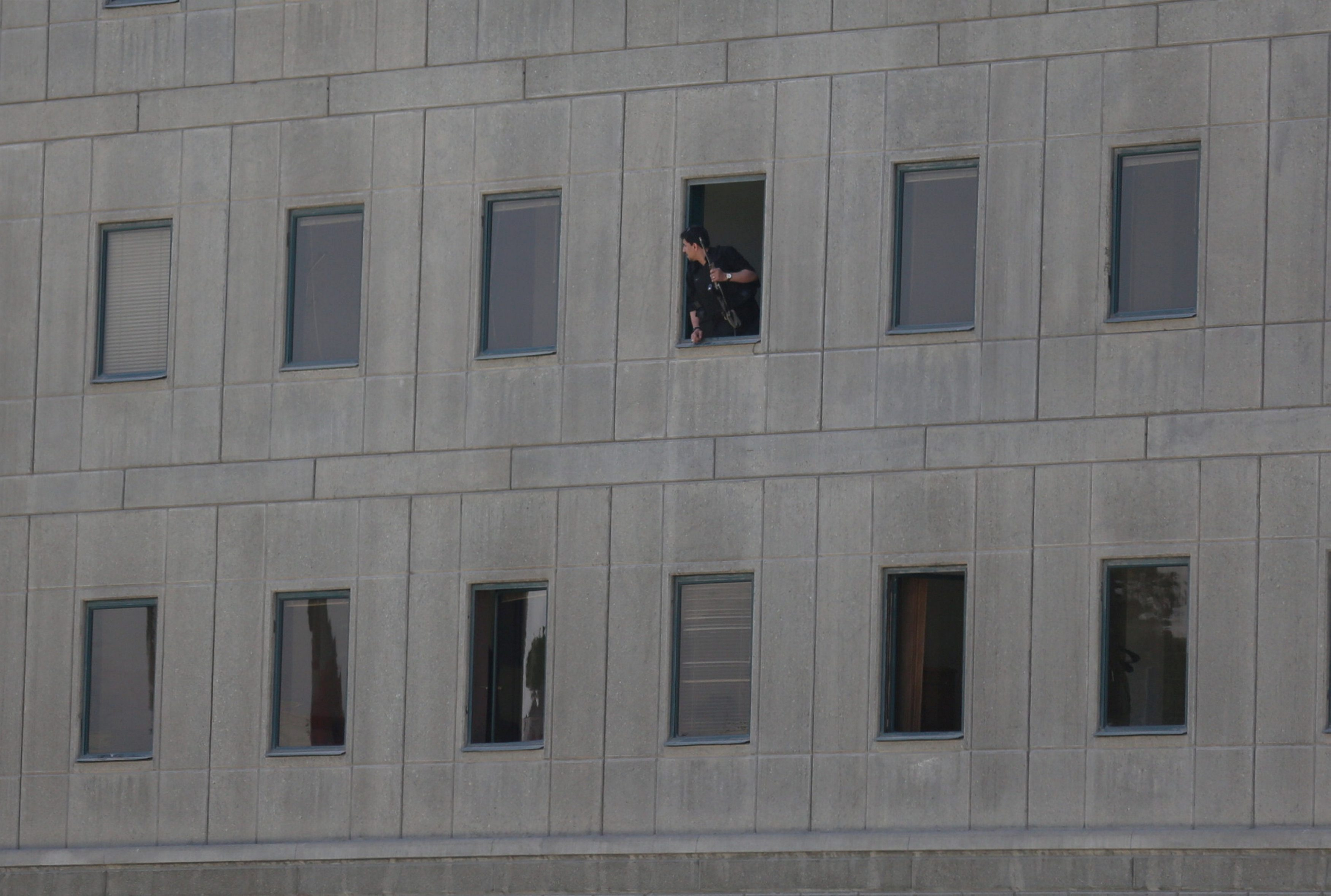 An Iranian policeman looks out of the parliament's building in central Tehran, Iran, June 7, 2017. TIMA via REUTERS ATTENTION EDITORS - THIS IMAGE WAS PROVIDED BY A THIRD PARTY. FOR EDITORIAL USE ONLY.