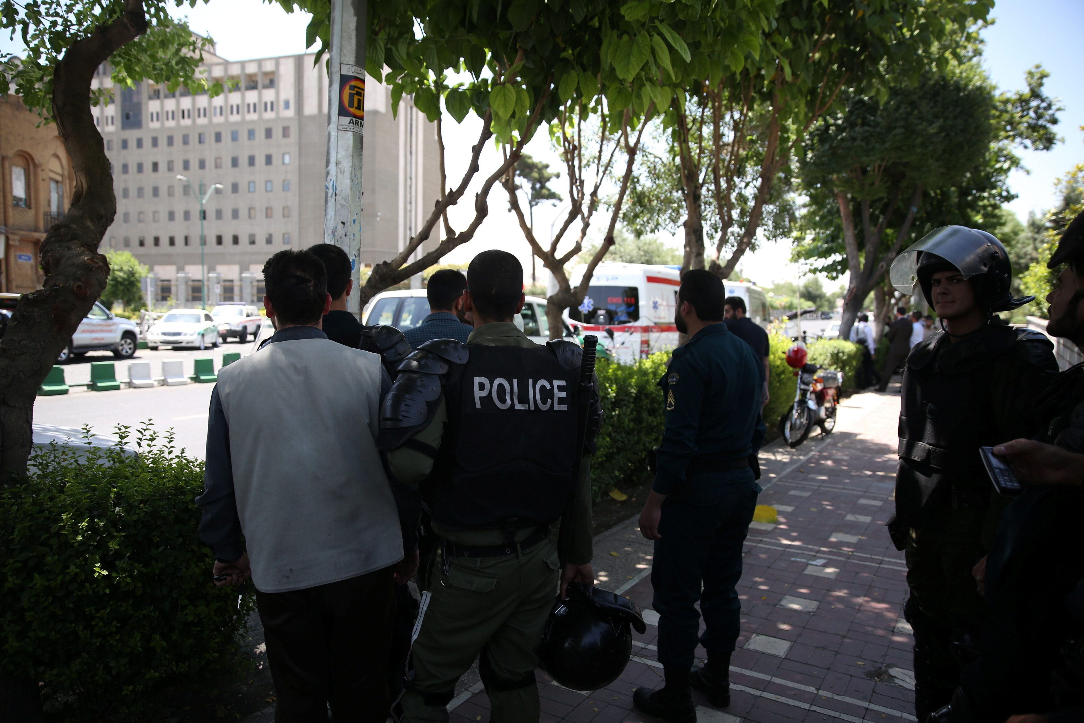 Iranian police stand near the parliament's building during a gunmen attack in central Tehran, Iran, June 7, 2017. TIMA via REUTERS ATTENTION EDITORS - THIS IMAGE WAS PROVIDED BY A THIRD PARTY. FOR EDITORIAL USE ONLY.