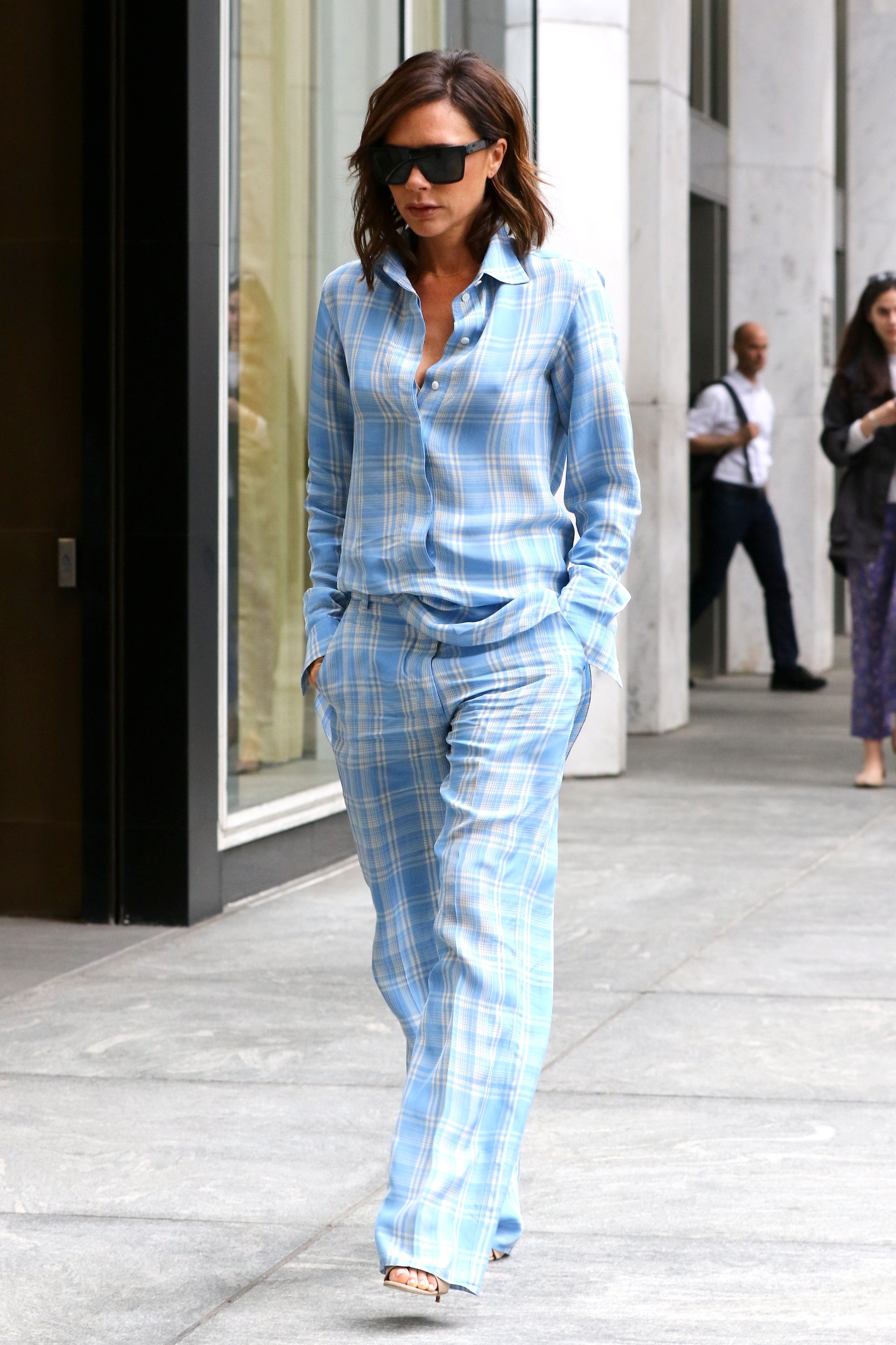 New York, NY  - Victoria Beckham struts her stuff after attending a business meeting in Manhattan today.  The former singer turned fashion designer rocked a trendy blue plaid shirt with matching trousers for today's look.  Pictured: Victoria Beckham  BACKGRID USA 7 JUNE 2017   USA: +1 310 798 9111 / usasales@backgrid.com  UK: +44 208 344 2007 / uksales@backgrid.com  *UK Clients - Pictures Containing Children Please Pixelate Face Prior To Publication*, Image: 335615791, License: Rights-managed, Restrictions: , Model Release: no, Credit line: Profimedia, AKM-GSI