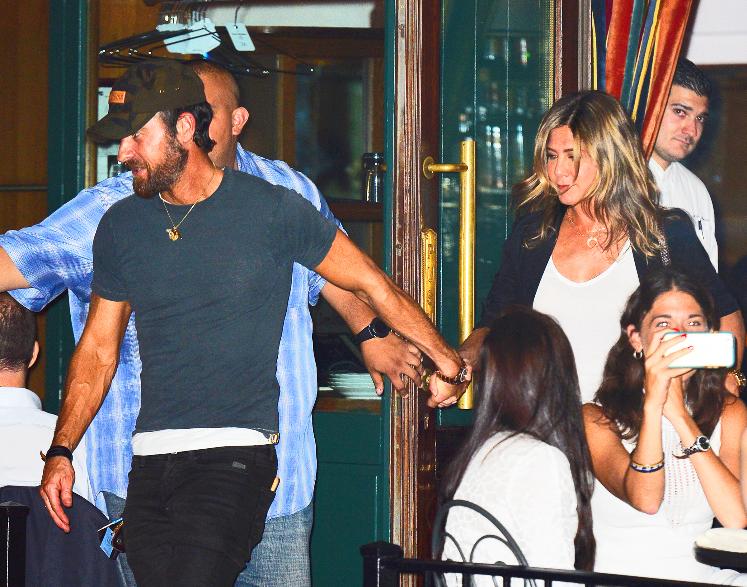 Jennifer Aniston and Justin Theroux are hand in hand as they leave Sant Ambroeus restaurant in New York City.  <P> Pictured: Jennifer Aniston and Justin Theroux <B>Ref: SPL1540887  190717  </B><BR/> Picture by: Splash News<BR/> </P><P> <B>Splash News and Pictures</B><BR/> Los Angeles:310-821-2666<BR/> New York:212-619-2666<BR/> London:870-934-2666<BR/> <span id=
