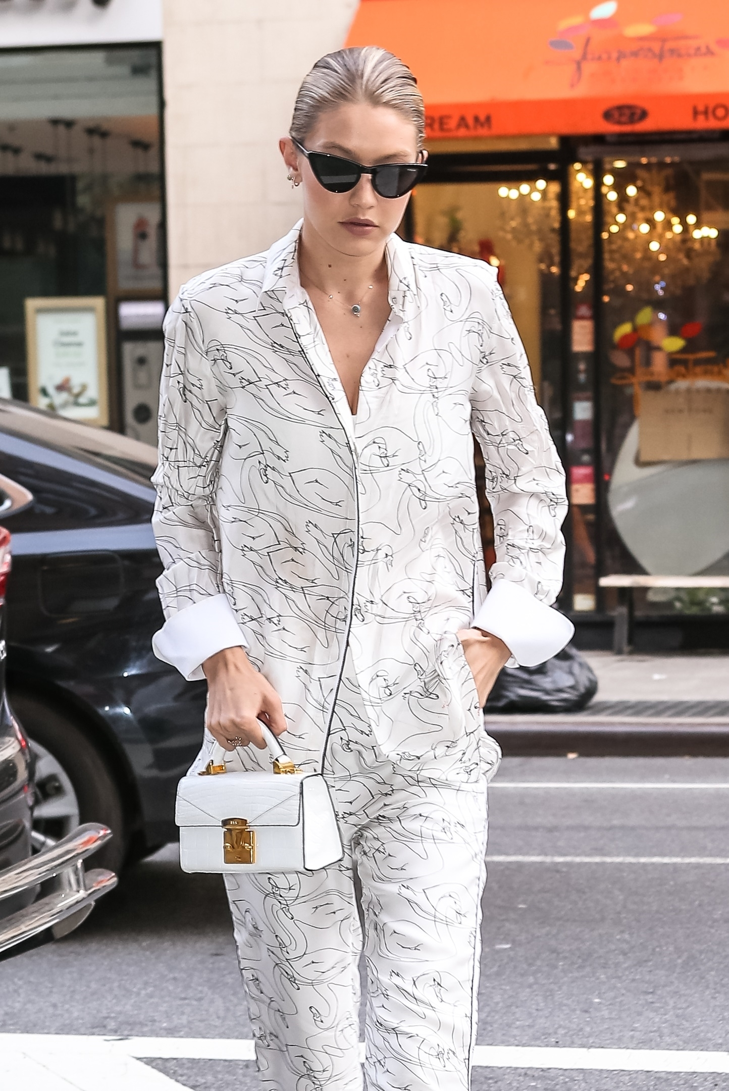 NY, NY  - Gigi Hadid steps out for a dinner with her family. Gigi stands out in an all white ensemble as she shows off her bright red Louis Vuitton bag.  Pictured: Gigi Hadid  BACKGRID USA 17 JULY 2017   USA: +1 310 798 9111 / usasales@backgrid.com  UK: +44 208 344 2007 / uksales@backgrid.com  *UK Clients - Pictures Containing Children Please Pixelate Face Prior To Publication*, Image: 342235860, License: Rights-managed, Restrictions: , Model Release: no, Credit line: Profimedia, AKM-GSI