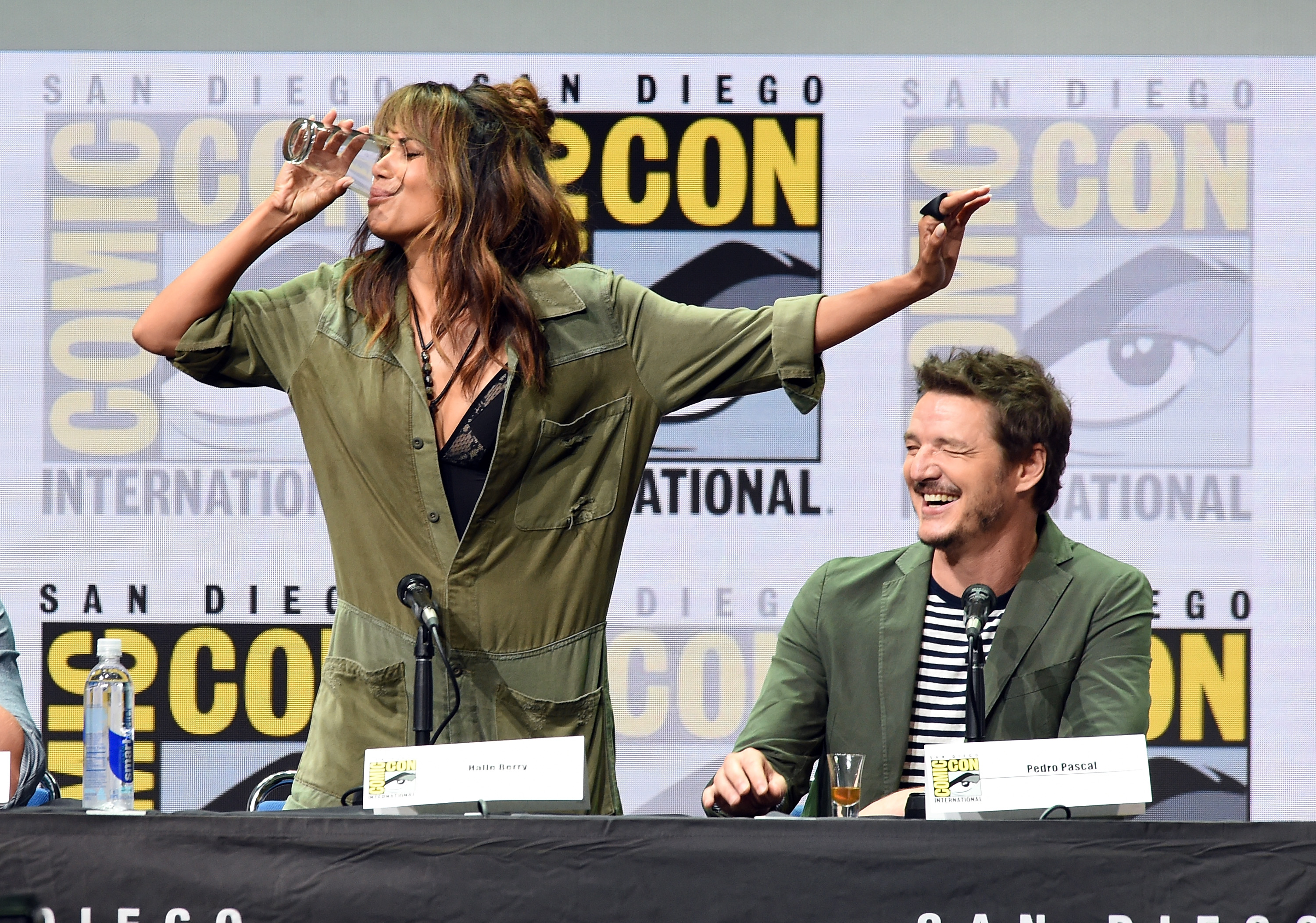 SAN DIEGO, CA - JULY 20:  Actor Halle Berry (L) takes a drink onstage while actor Pedro Pascal looks on at the 20th Century FOX panel during Comic-Con International 2017 at San Diego Convention Center on July 20, 2017 in San Diego, California.  (Photo by Kevin Winter/Getty Images)