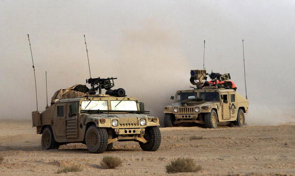 IRAQ - MARCH 23:  U.S. Army 3rd Infantry Division Scout humvees move deeper into Iraqi territory March 23, 2003 south of the city of An Najaf, Iraq. U.S. and British forces continue to assault Iraq from land, sea and air as part of the ongoing Operation Iraqi Freedom.  (Photo by Scott Nelson/Getty Images)