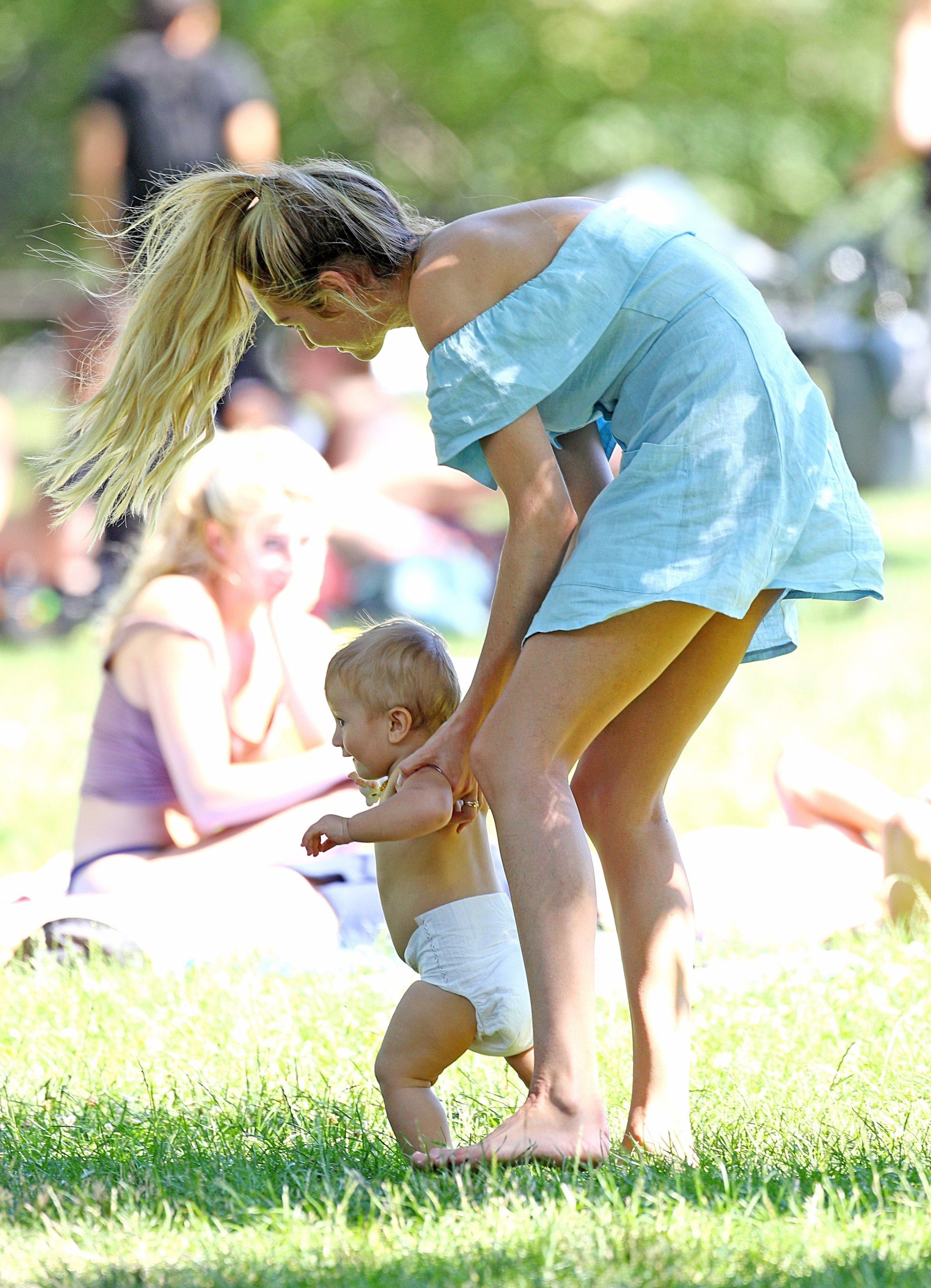 New York, NY  - *EXCLUSIVE*  - Candice Swanepoel and fiance Hermann Nicoli enjoy a day in the park with their son Anaca in New York. Anaca could be seen laughing and smiling as he enjoyed the nice weather in just his diaper.  Pictured: Candice Swanepoel, Anaca Nicoli  BACKGRID USA 3 JULY 2017   USA: +1 310 798 9111 / usasales@backgrid.com  UK: +44 208 344 2007 / uksales@backgrid.com  *UK Clients - Pictures Containing Children Please Pixelate Face Prior To Publication*, Image: 340528573, License: Rights-managed, Restrictions: , Model Release: no, Credit line: Profimedia, AKM-GSI