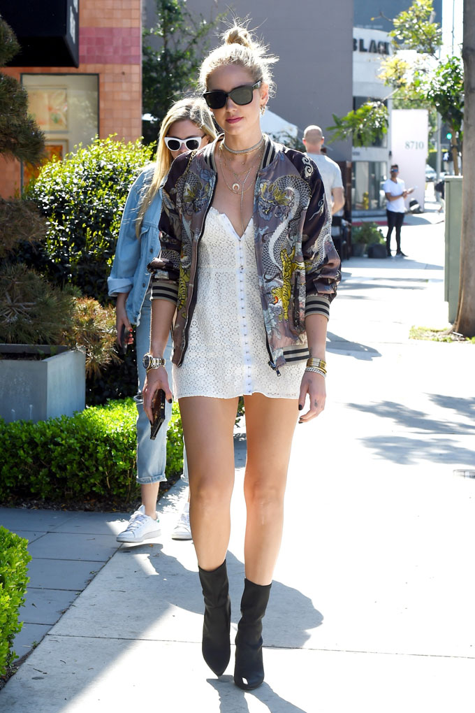 AG_184555 - West Hollywood, CA  - Calabasas, CA - Fashion blogger Chiara Ferragni grabs lunch at Cafe Zinque. She looks cute in a white mini dress paired with a letterman's jacket that has a tiger print on it.  Pictured: Chiara Ferragni  28 MARCH 2017, Image: 326875252, License: Rights-managed, Restrictions: , Model Release: no, Credit line: Profimedia, AKM-GSI