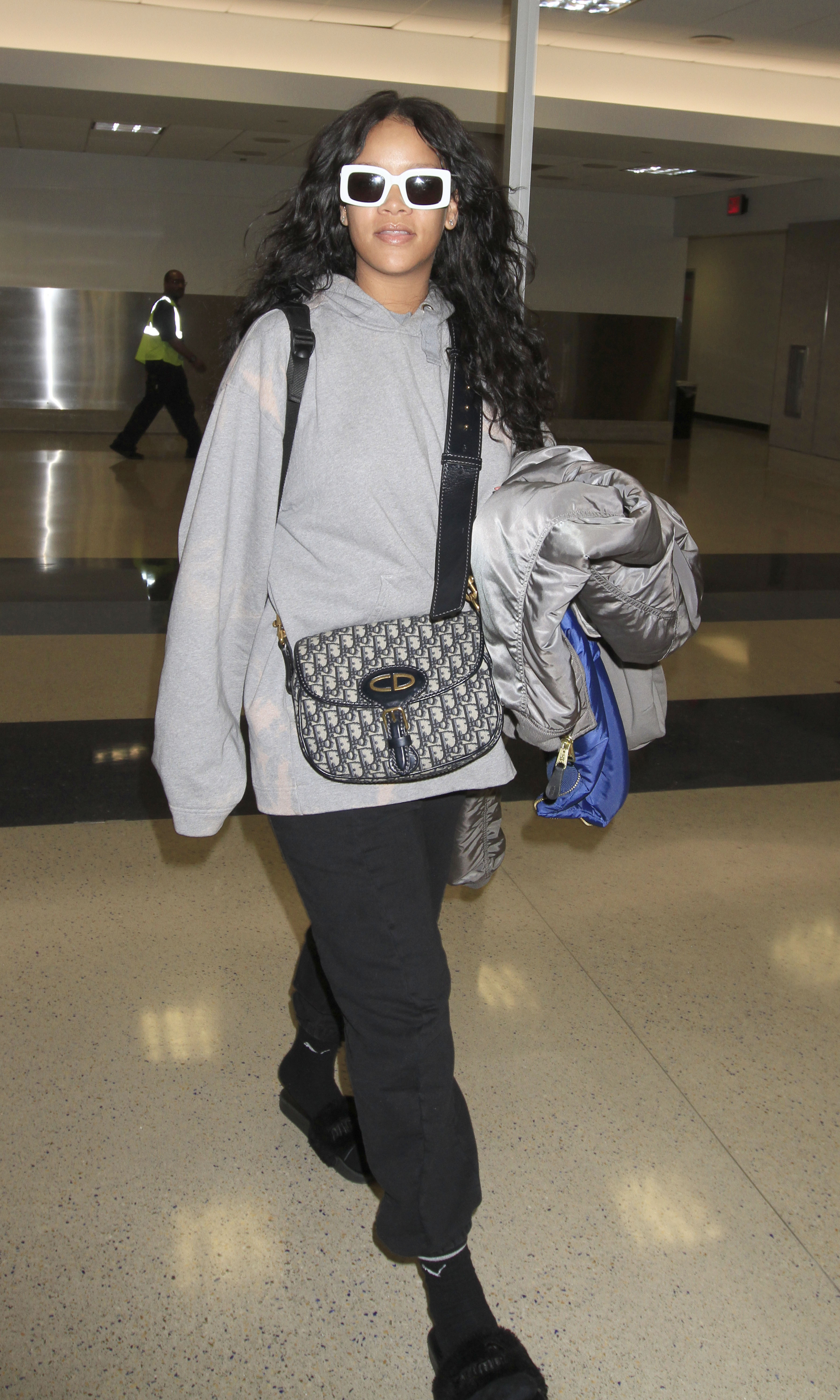 Rihanna spotted in LA after reports that she was getting cozy with an Olympic fencer.  The iconic musician was seen in an oversized sweatshirt, black sweatpants and white sunglasses.  Rihanna was in good spirits for her arrival into LAX. <P> Pictured: Rihanna <B>Ref: SPL1492735  050517  </B><BR/> Picture by: Sharky/Polite Paparazzi/SPLASH <BR/> </P><P> <B>Splash News and Pictures</B><BR/> Los Angeles:310-821-2666<BR/> New York:212-619-2666<BR/> London:870-934-2666<BR/> <span id=