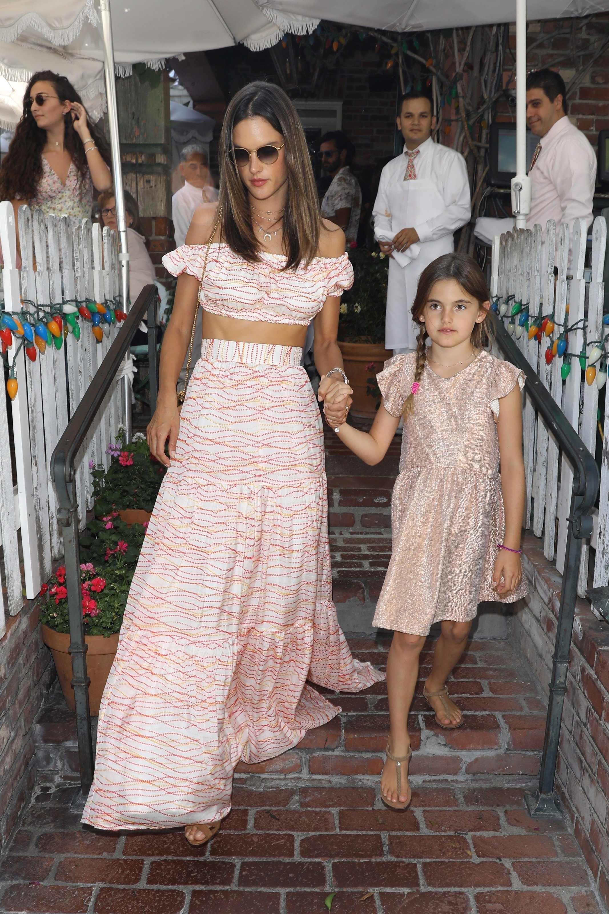 West Hollywood, CA  - Alessandra Ambrosio shows off a matching top and skirt for lunch at The Ivy with her daughter Anja for her 9th birthday and son Noah. Alessandra looks great as she shows off the tanned and toned skin while walking with her birthday girl after lunch together.  Pictured: Alessandra Ambrosio  BACKGRID USA 24 AUGUST 2017, Image: 346405730, License: Rights-managed, Restrictions: , Model Release: no, Credit line: Profimedia, AKM-GSI