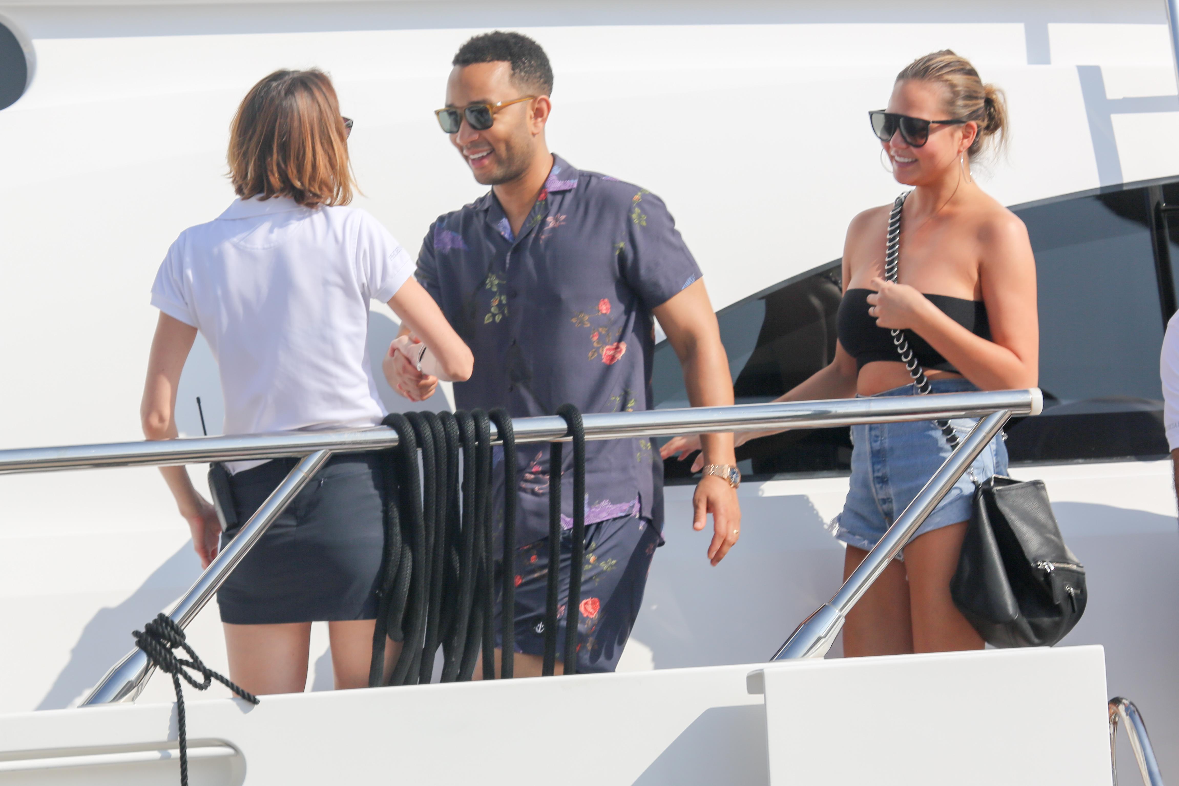 August 26, 2017 - Saint Tropez, FRANCE - John Legend and Chrissy Teigen on a yacht in Saint Tropez. <P> Pictured: John Legend and Chrissy Teigen <B>Ref: SPL1562509  260817  </B><BR/> Picture by: Splash News<BR/> </P><P> <B>Splash News and Pictures</B><BR/> Los Angeles:310-821-2666<BR/> New York:212-619-2666<BR/> London:870-934-2666<BR/> <span id=