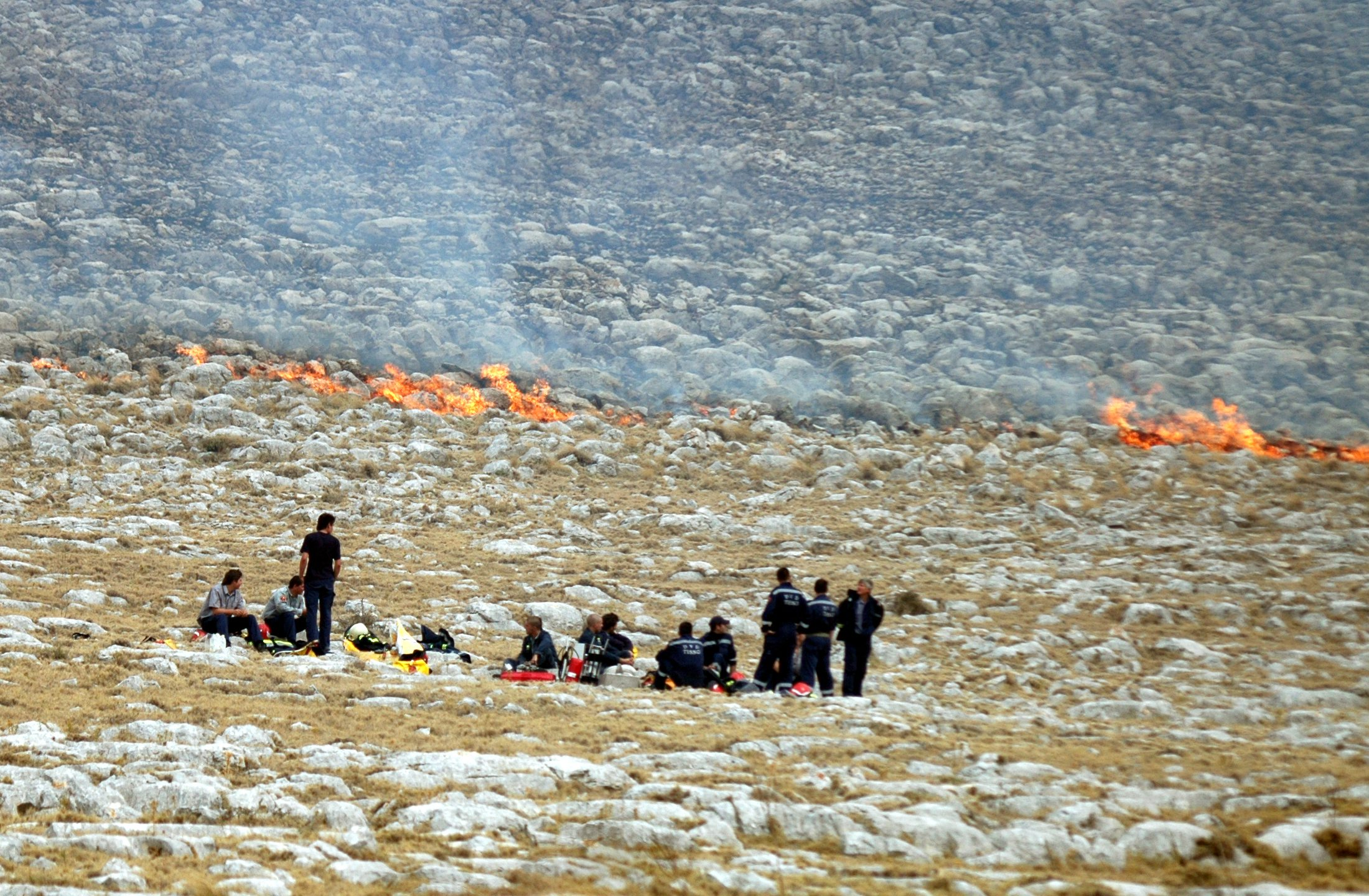 Kornati, 300807. Vatrogasci u momentu nakon desanta na Kornat. Pozar na Kornatu. Foto: Stanko Feric -desk JL-