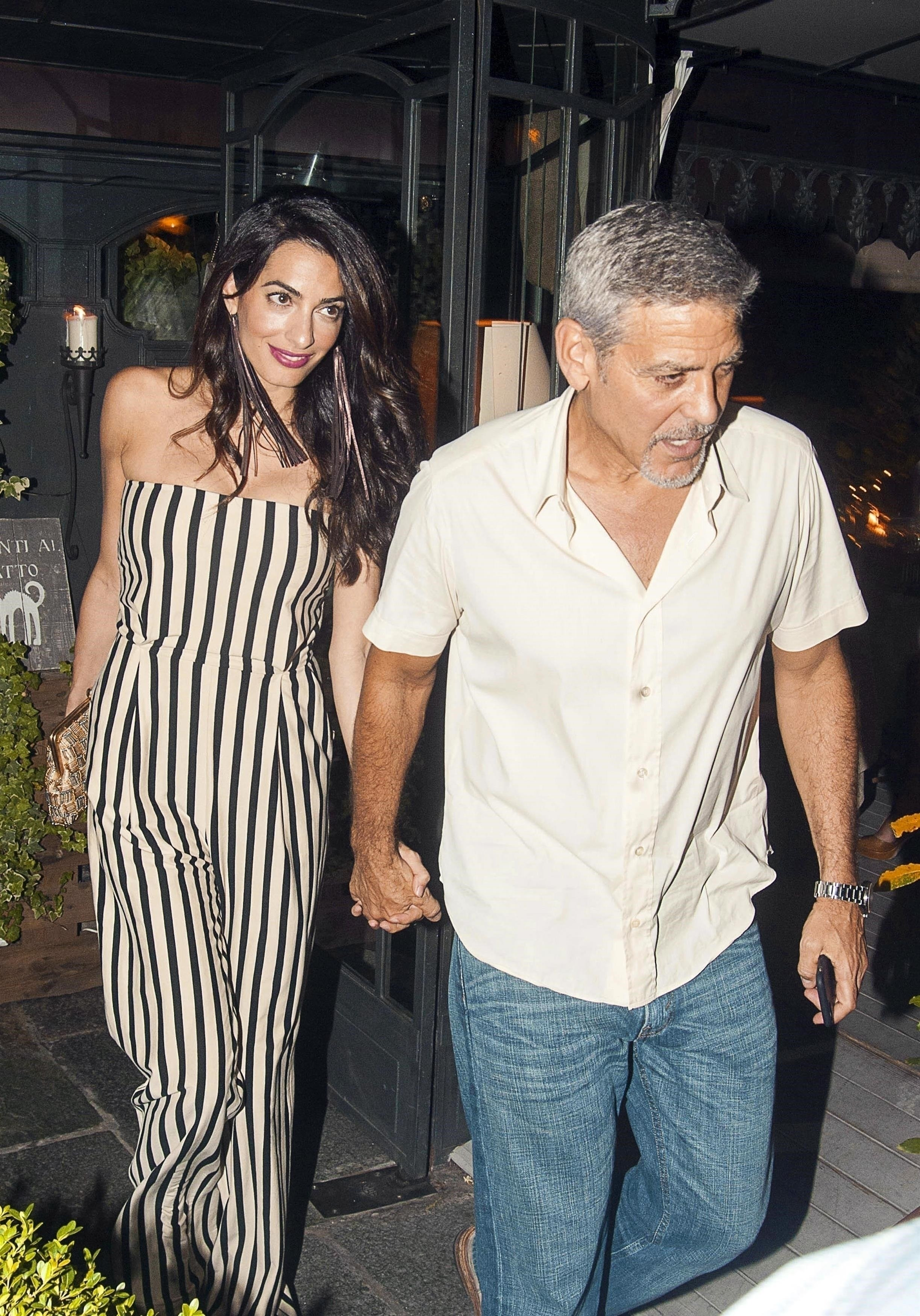 ** RIGHTS: WORLDWIDE EXCEPT IN FRANCE, GERMANY, ITALY, SPAIN, SWITZERLAND ** COMO, ITALY  - *PREMIUM-EXCLUSIVE*-*MUST CALL FOR PRICING BEFORE USAGE*-*STRICTLY NOT AVAILABLE FOR ONLINE SUBSCRIPTIONS* Hollywood actor George Clooney pictured with wife Amal Clooney as they are seen enjoying a romantic dinner along with Amal's Mother Baria at Gatto Nero Restaurant in Lake Como. *PICTURES TAKEN ON 5/08/2017*  Pictured: George and Amal Clooney  BACKGRID UK 8 AUGUST 2017   UK: +44 208 344 2007 / uksales@backgrid.com  USA: +1 310 798 9111 / usasales@backgrid.com  *UK Clients - Pictures Containing Children Please Pixelate Face Prior To Publication*, Image: 344466905, License: Rights-managed, Restrictions: , Model Release: no, Credit line: Profimedia, Xposurephotos