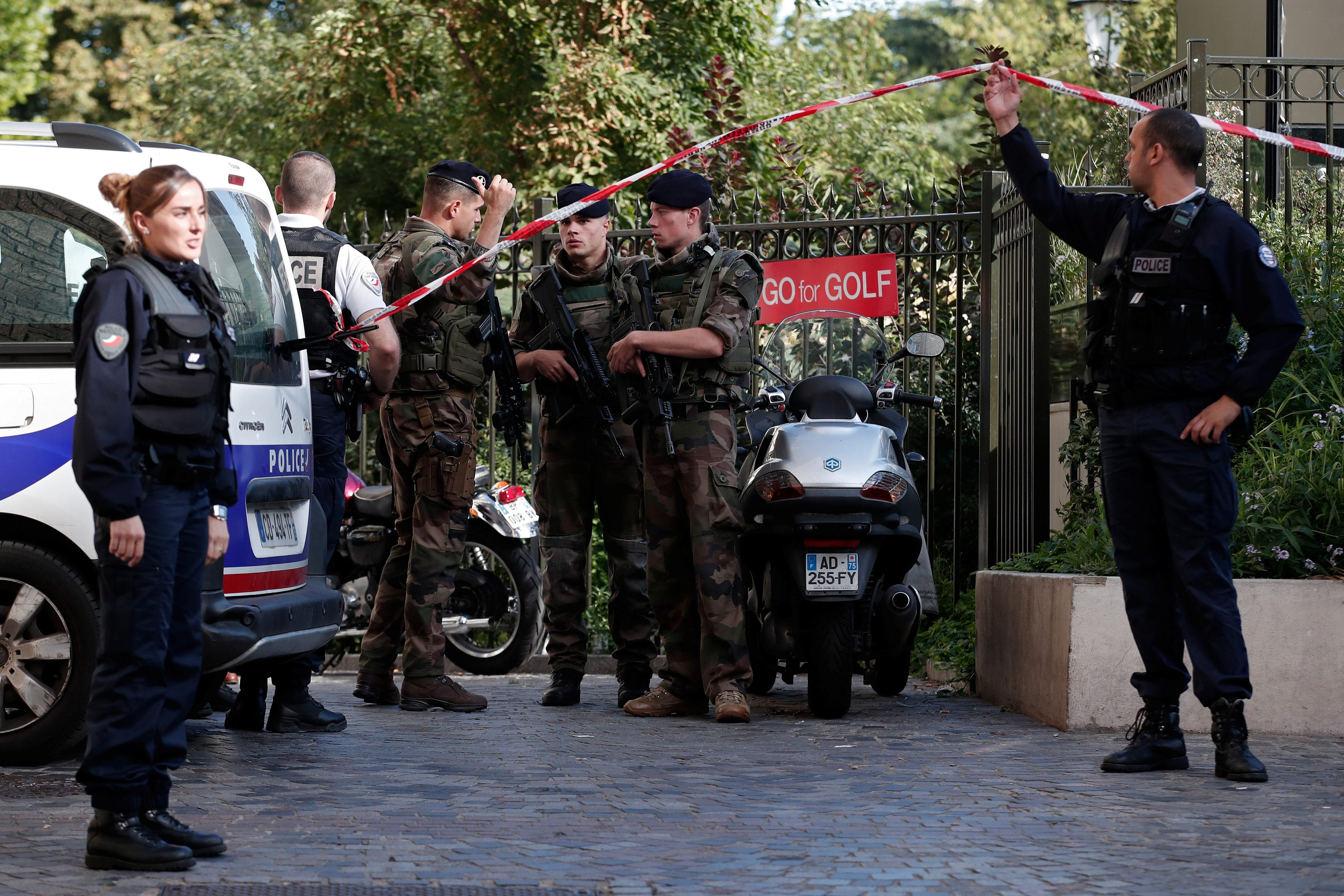 Police and soldiers secure the scene where French soliders were hit and injured by a vehicle in the western Paris suburb of Levallois-Perret, France, August 9, 2017.     REUTERS/Benoit Tessier