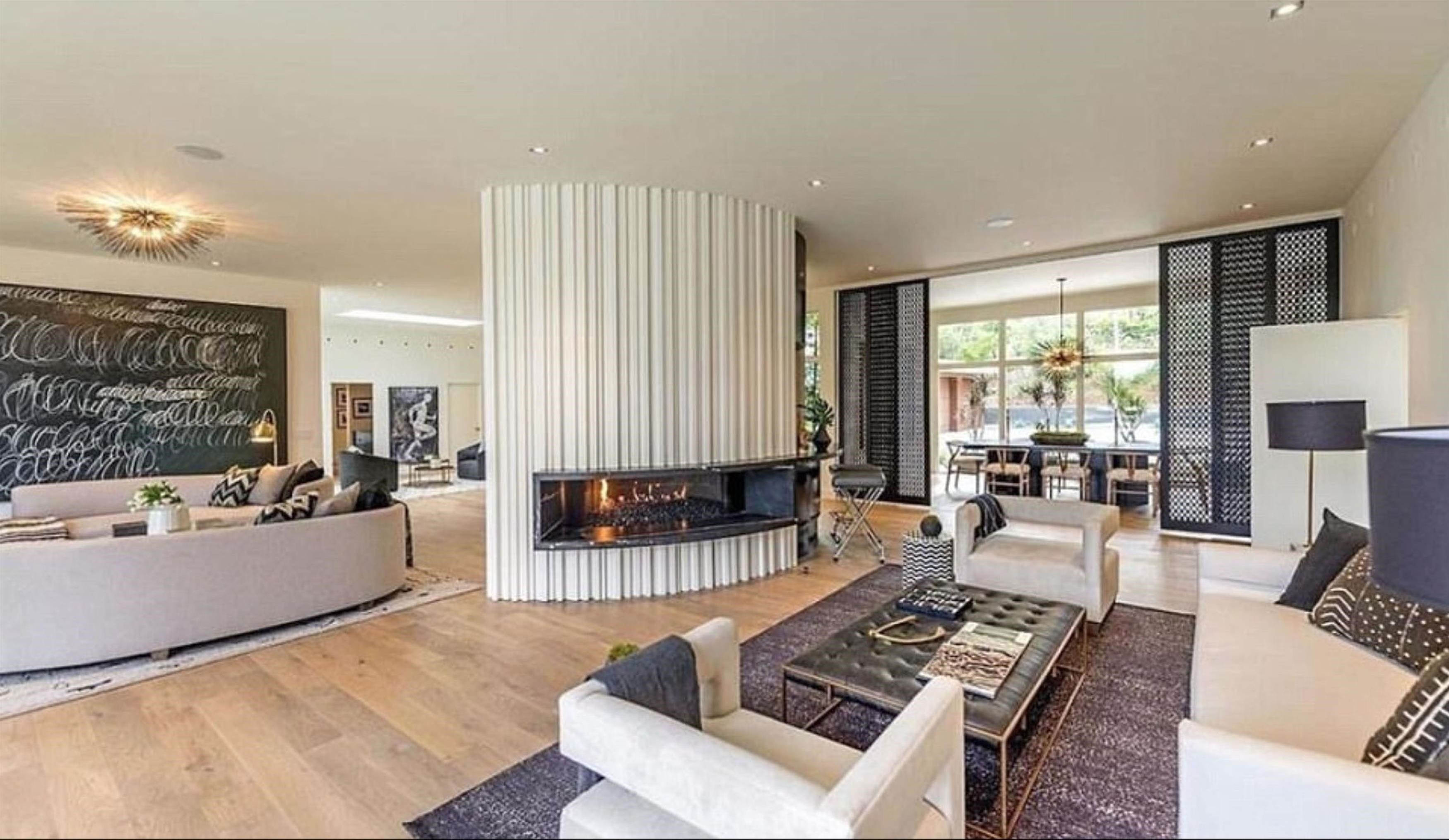 ** RIGHTS: WORLDWIDE EXCEPT IN UNITED STATES ** Los Angeles, CA  - Cindy Crawford and Randy Gerber splash out  million on new Beverly Hills home. The Hollywood couple put their luxury Malibu abode on the market in November 2016 for a cool million - and now they have swapped their seaside home for a jaw-dropping pad in Beverly Hills. According to US reports, they purchased the one-storey contemporary home  in the idyllic 90210 zip code for million. The property is located in trhe neighbourhood of Trousdale Estates and was originally listed for an eye-water .75million. The deal reportedly closed earlier this week with the dynamic couple purchasing the home from OneRepublic singer Ryan Tedder - who has worked with U2, Beyonce, Adele and Ed Sheeran. Cindy and Rande's four bedroom property is equipped with an impressive outdoor area and pool and a fire pit. The modern home boasts an open plan living area and kitchen which flows perfectly into their manicured lawns and incredible view over the city with the help of folding glass doors. Flooding  Pictured: Cindy Crawford, Randy Gerber  BACKGRID UK 14 SEPTEMBER 2017, Image: 349341312, License: Rights-managed, Restrictions: , Model Release: no, Credit line: Profimedia, Xposurephotos